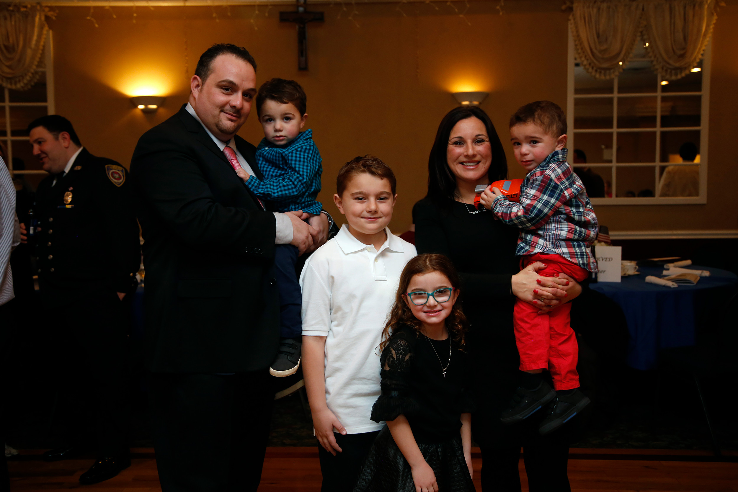 Bryan Lanzello, left, celebrated with his family after his company, Lanzello Roofing and Remodeling, Inc., was named Business of the Year at Lynbrook Mayor Bill Hendrick's annual awards ceremony at the Saint Mary's Knights of Columbus on Feb. 17.