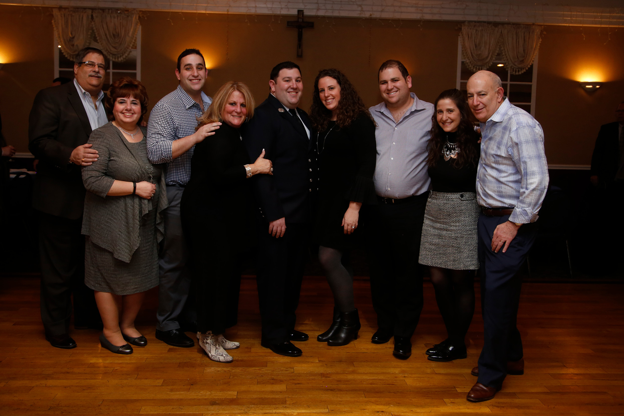 Firefighter Cory Hirsch, center, celebrated earning Lynbrook Fire Department First Responder of the Year with his family.