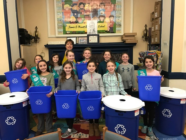 Junior Girl Scout Troop 808 raised over $300 to buy 27 recycling bins for Hewitt Elementary School.
