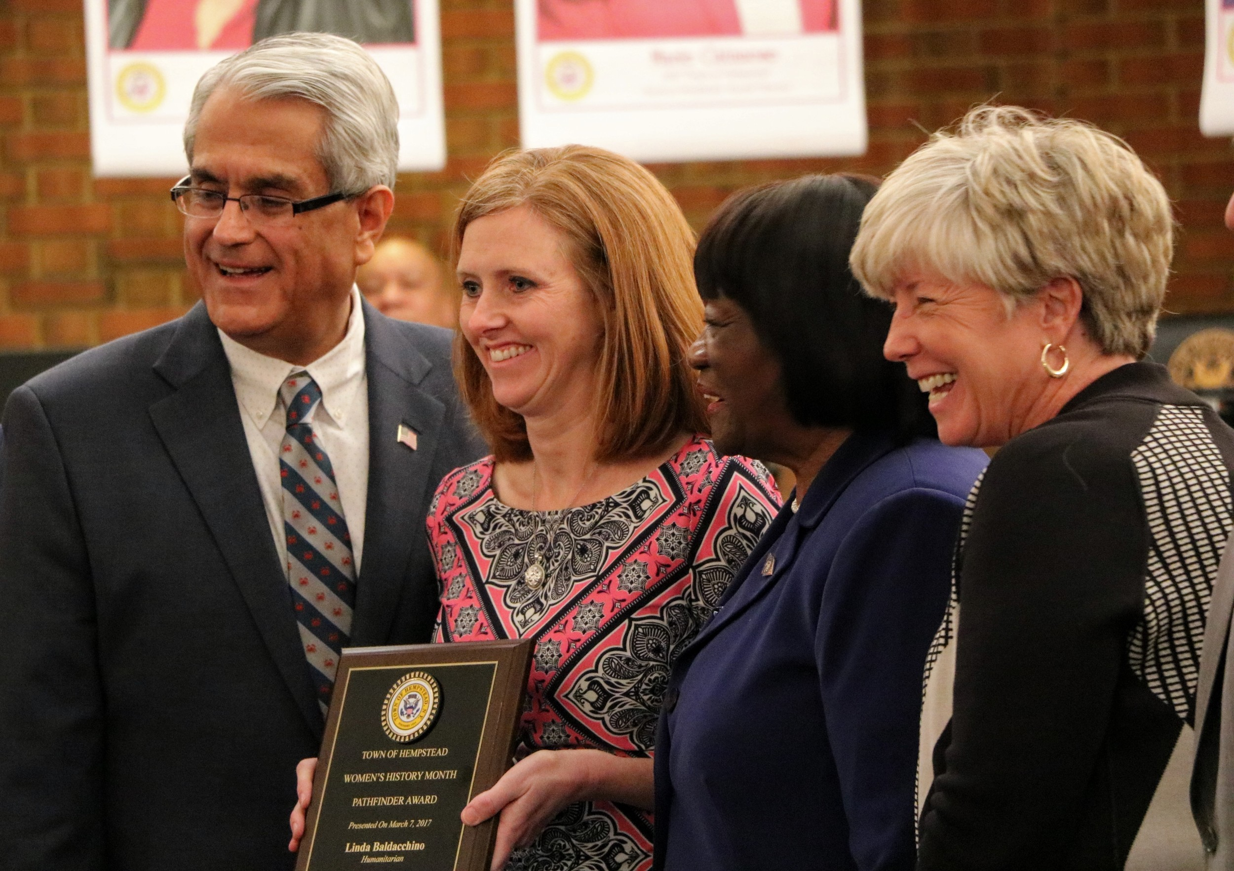 Linda Baldacchino, holding plaque, was presented with the Town of Hempstead's Pathfinder award in the Humanitarian category on March 7.  With her are Town Supervisor Anthony Santino, Malverne Mayor Patti Ann McDonald, far right, and Town Senior Councilwoman Dorothy Goosby.