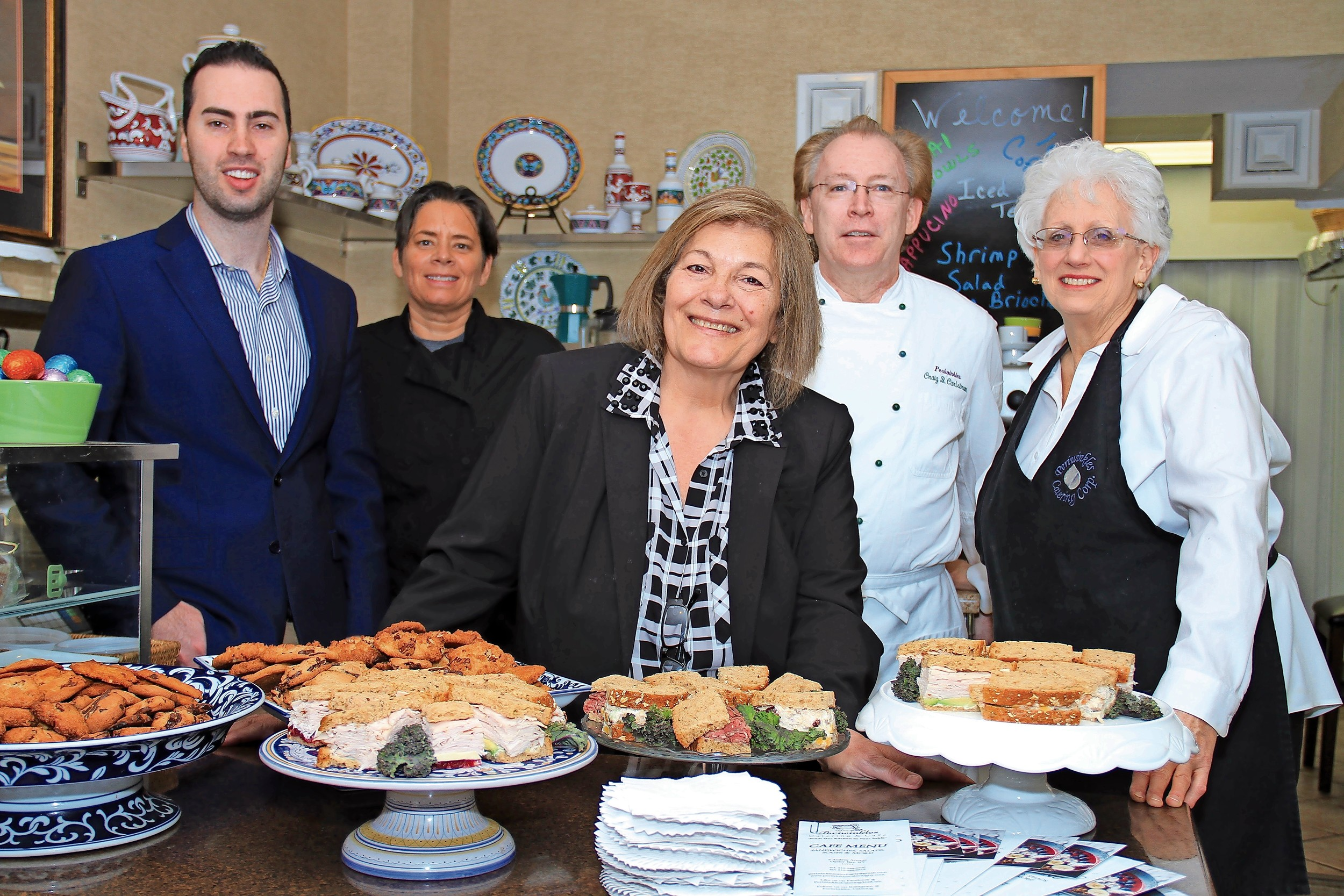 The owner of Periwinkles, Patrizia Spafford, center, with her staff at the grand reopening of the eatery.