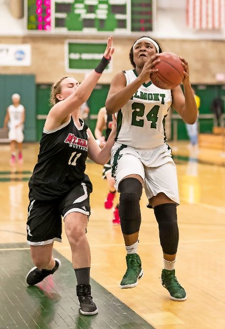 Junior Kem Nwabudu, right, scored 20 points to help the Lady Spartans defeat Mount Sinai, 58-51, in last Saturday's Long Island Class A championship game at SUNY-Old Westbury.