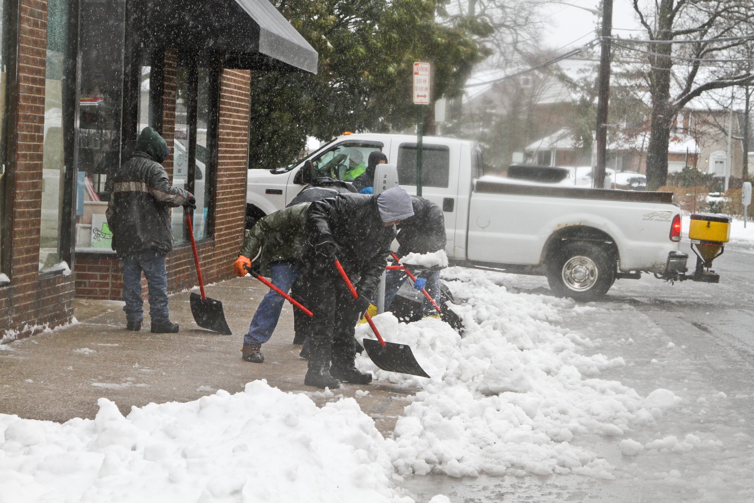 Clearing sidewalks in the Five Towns.