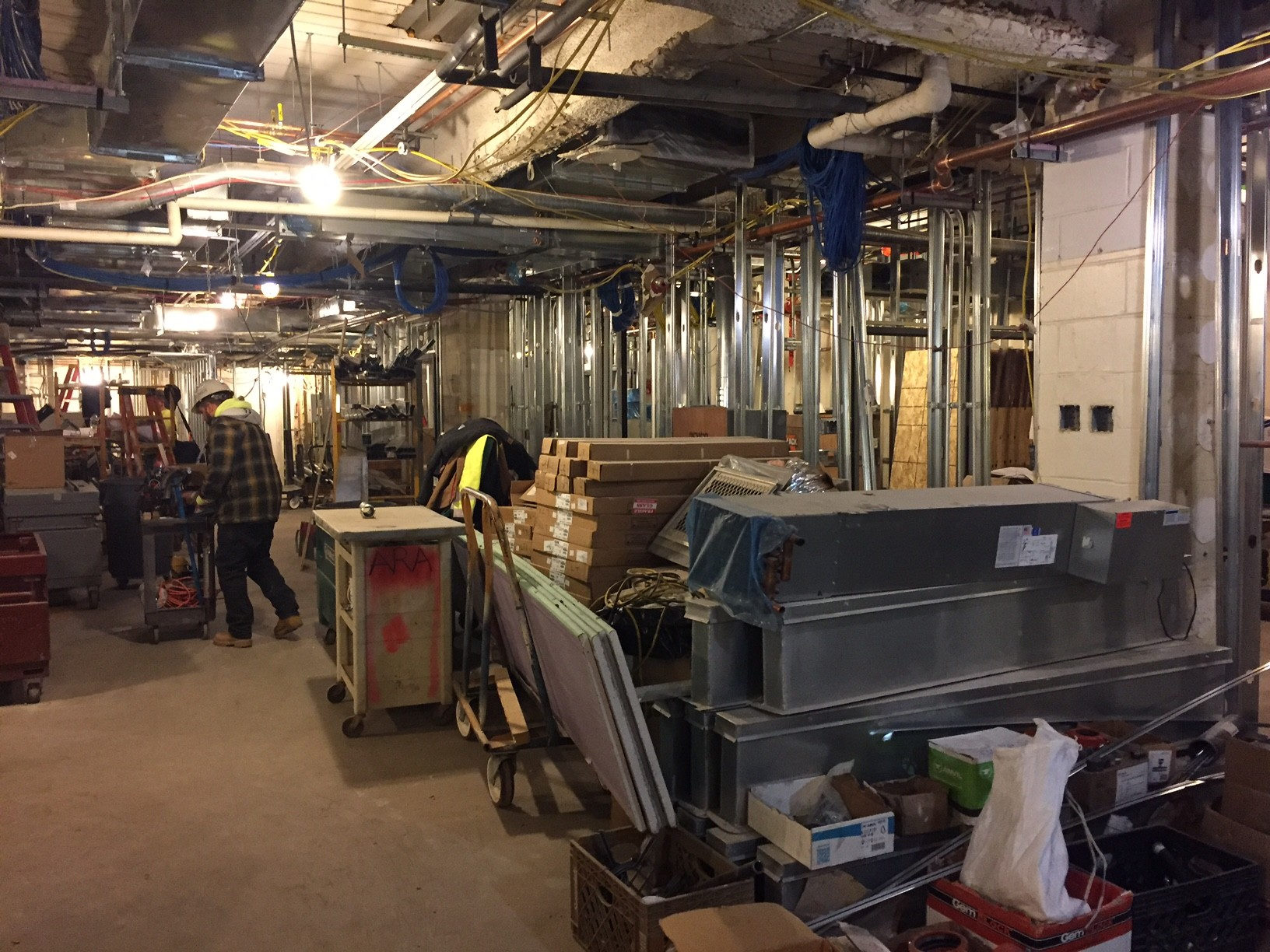 Workers are clearing a large machine room to free up 2,500 square feet for clinical space in South Nassau Communities Hospital's emergency department.