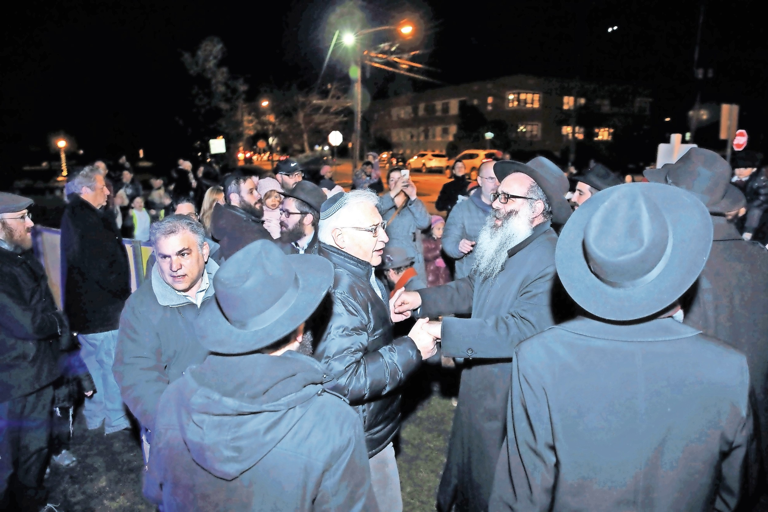 David Friedman, center left, and Rabbi Zalman Wolowik, celebrated Hanukkah at the Chabad of the Five Towns menorah lighting in December.