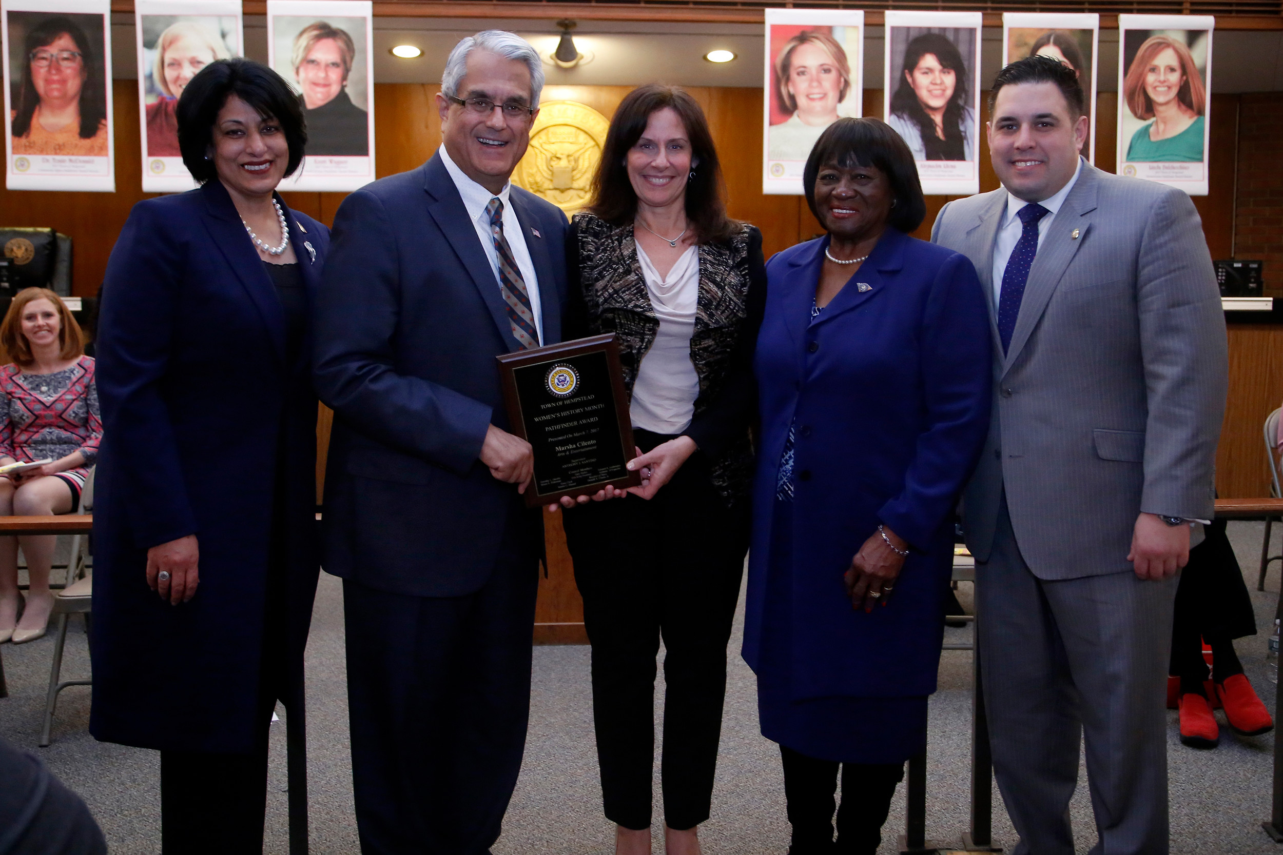 Marsha Cilento, center recieving the Arts & Entertainment Pathfinder Award with Town Clerk Nasrin Ahmad, far left, Hempstead Town Supervisor Anthony Santino, Town Councilwoman Dorothy Goosby, and Town Councilman Anthony D'Esposito.