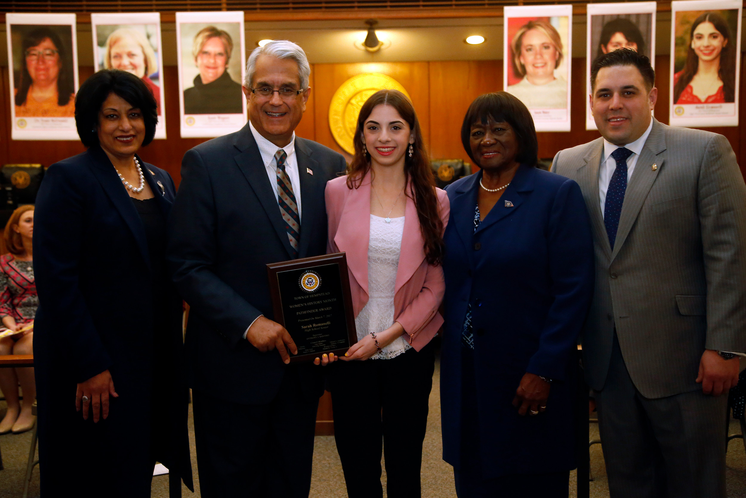 Sara Romanelli, receiving the High School Senior Award with Town Clerk Nasrin Ahmad, far left, Hempstead Town Supervisor Anthony Santino, Town Councilwoman Dorothy Goosby, and Town Councilman Anthony D'Esposito.