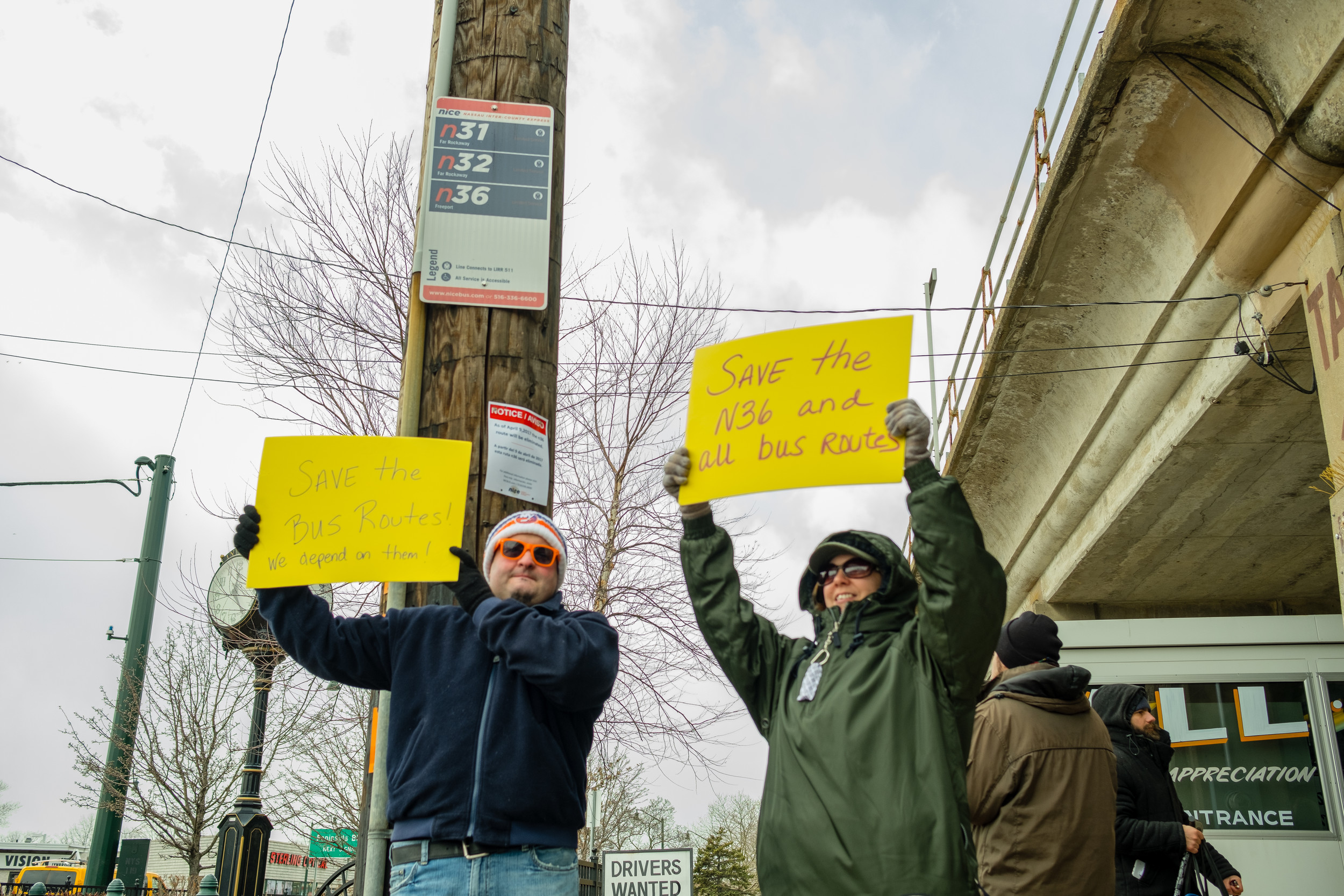 A group of about two dozen people - local residents, elected officials and bus riders - gathered to condemn the planned cut of the N36 NICE bus route. East Rockaway residents Joe and Laura Forgione got their message across.