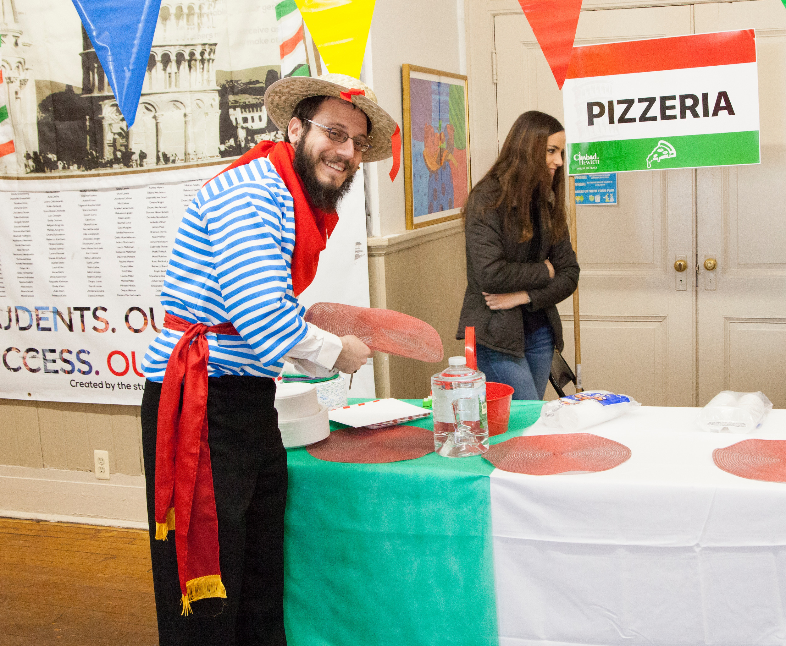 Rabbi Nochem Tenenboim opened the Pizza station at the Chabad of Hewlett's Italian-style on March 12.