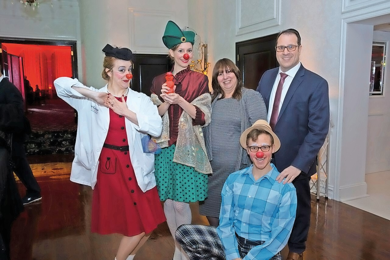 Couture For A Cause honored The Lev Leytzan clowns, founded by Dr. Neal Goldberg, far right.