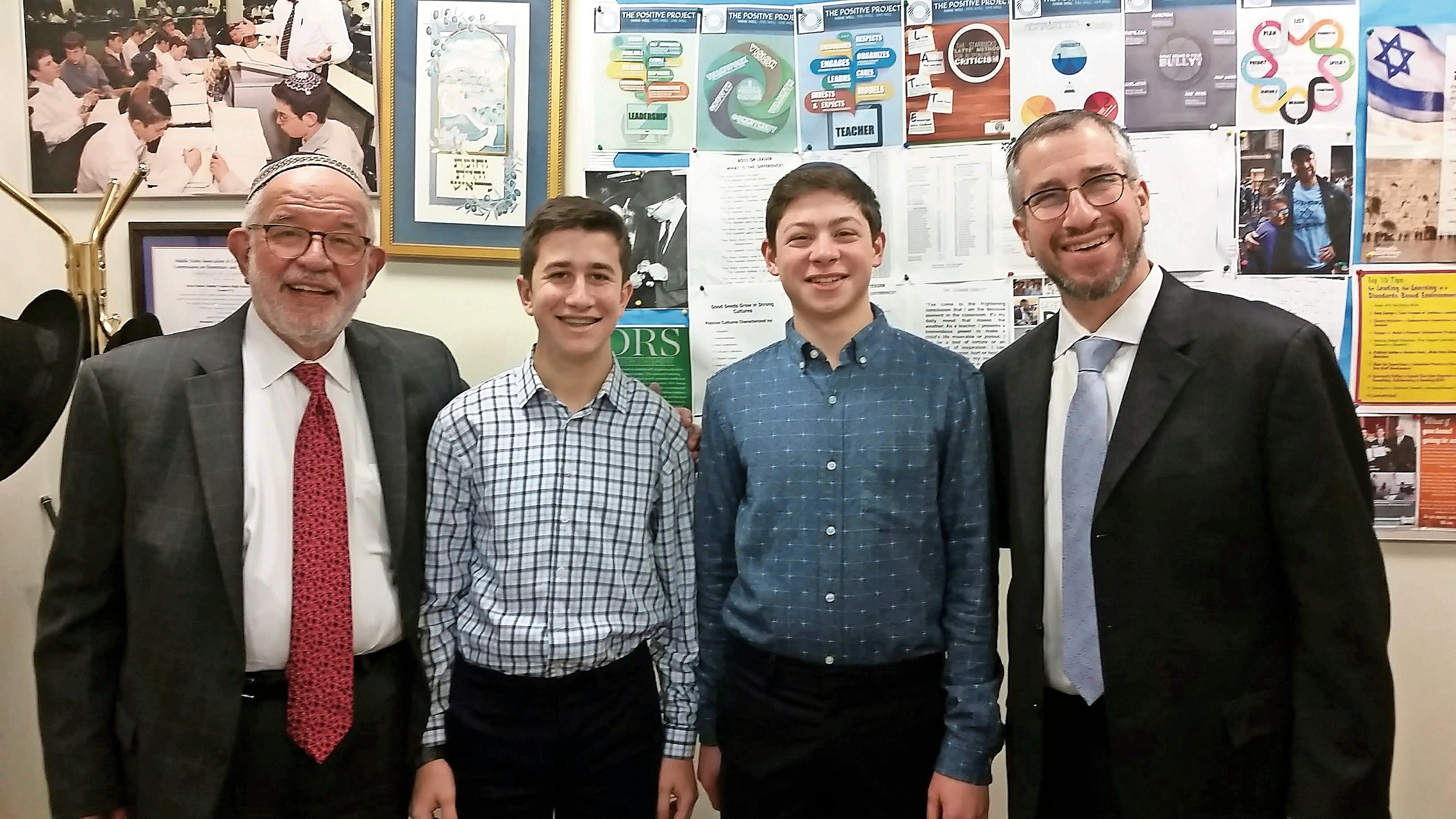 DRS juniors Aaron Singer and Uri Ash finished first and fifth, respectively, in the National Jerusalem Science Contest. From left were Rabbi Yisroel Kaminetsky, Singer, Ash, Singer, Ash, and Principal Dr. Gerald Kirshenbaum.