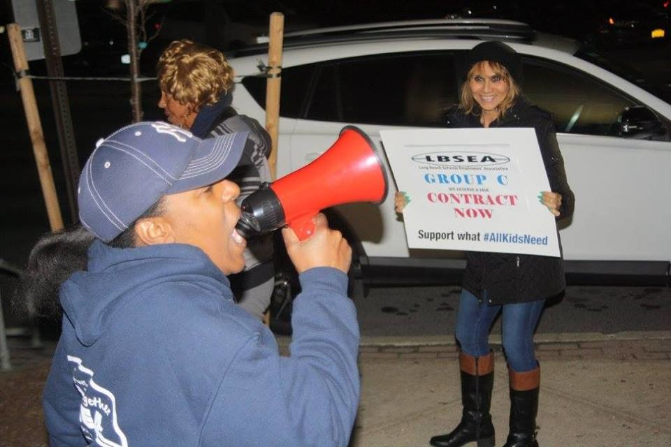 Hundreds of Long Beach School Employees Association members were joined by members of the City Council and Long Beach Professional Firefighters Local 287 at a rally led by Veronica Dale, left, before the March 9 Board of Education meeting to protest what they called a lack of progress in contract negotiations.