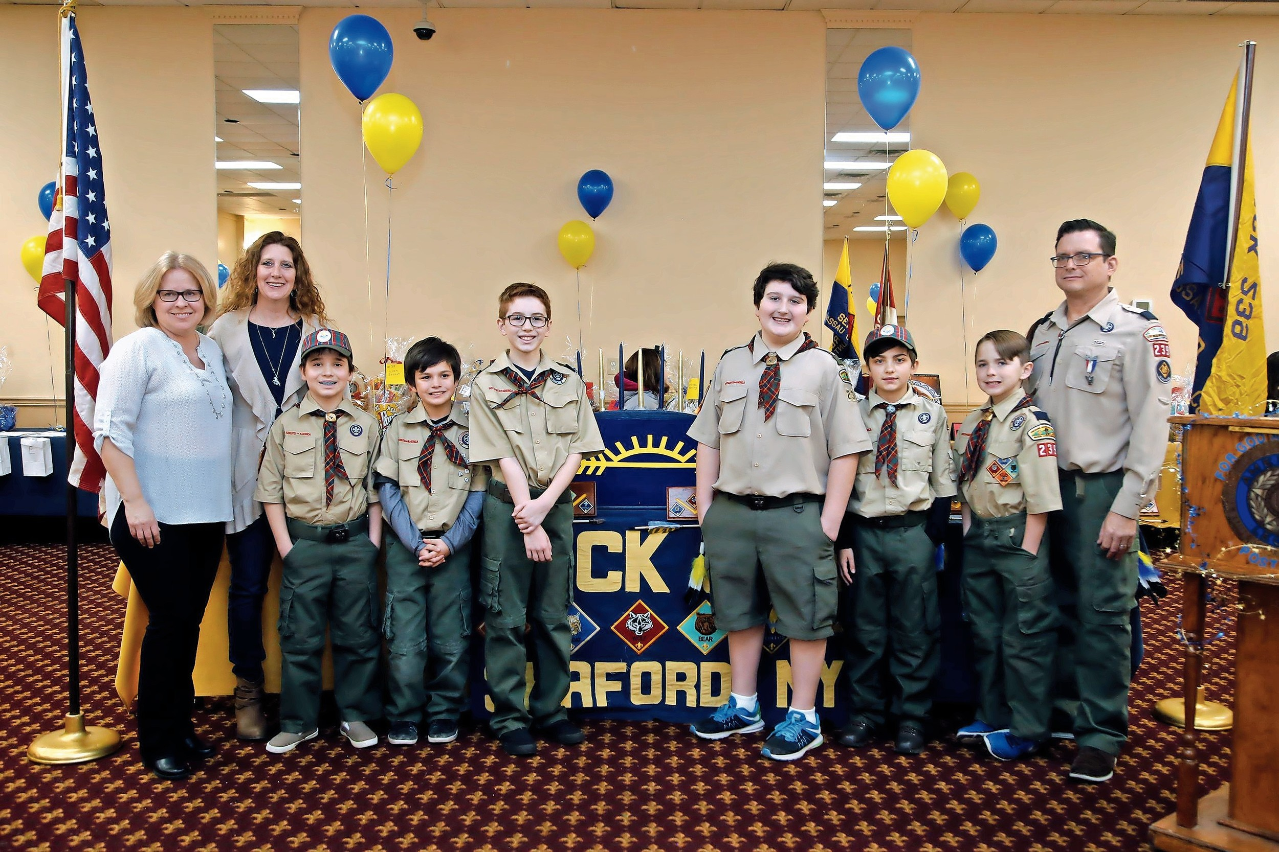 Teija Minerva, Webelos 11 den leader, Treasurer Mary Murphy and Cubmaster James Price congratulated the Arrow of Light honorees — Mikko Minerva, AJ Flores, Luke Donovan, Brendan Murphy, Charles Herman and James Price — at the banquet on March 5.