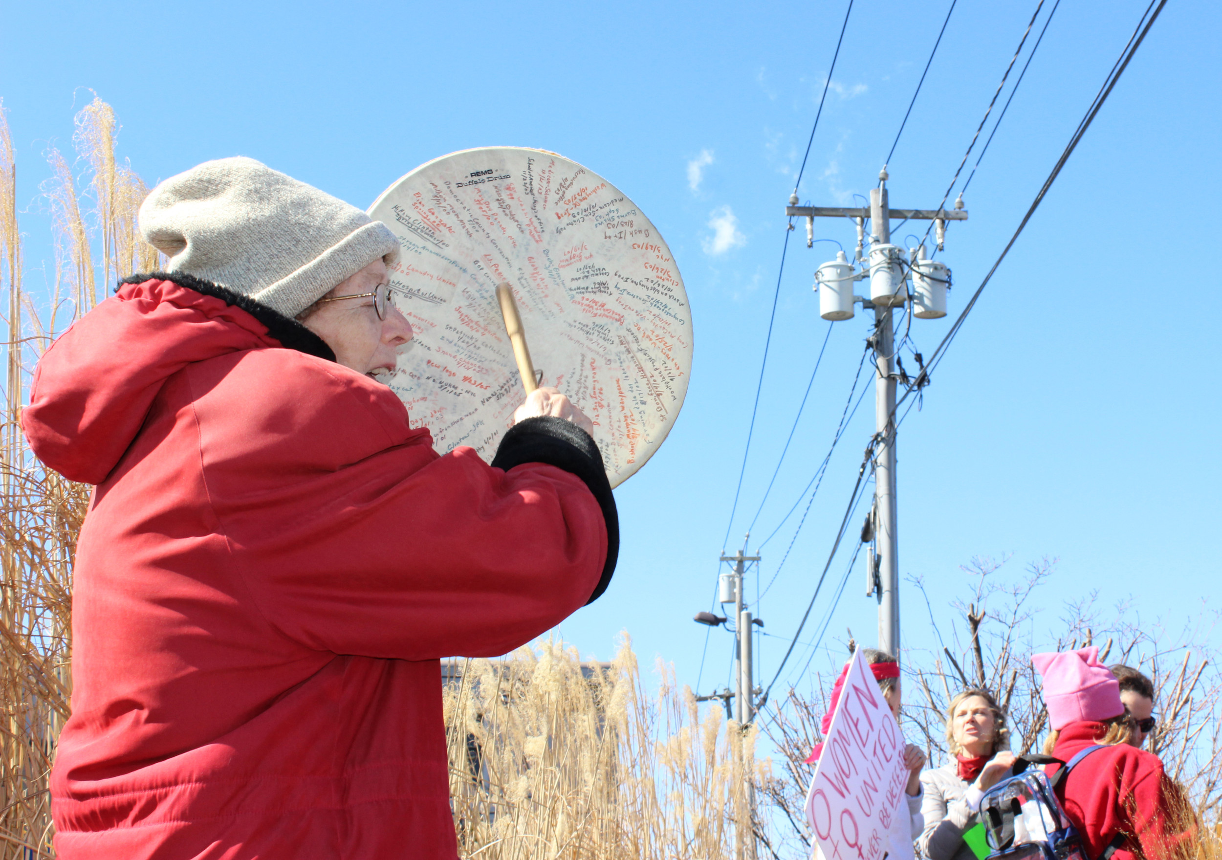Nancy Dwyer, 82, has been attending local rallies since 1999. She marks the date of each protest on a handheld drum and bangs it to grab the attention of passersby.