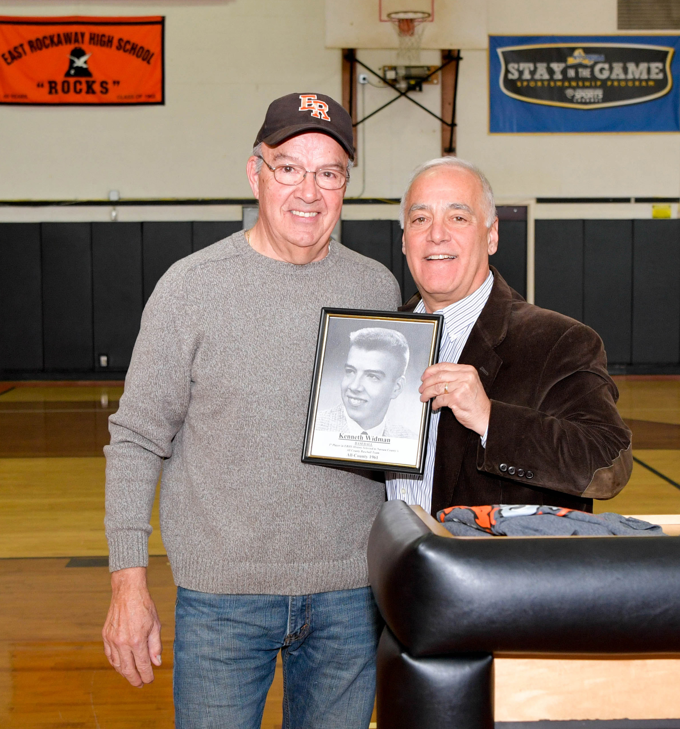 Former baseball star Ken Widman, left, was inducted into East Rockaway's athletic Wall of Fame this month with a cermony arranged in part by Athletic Director Dom Vulpis, at right.