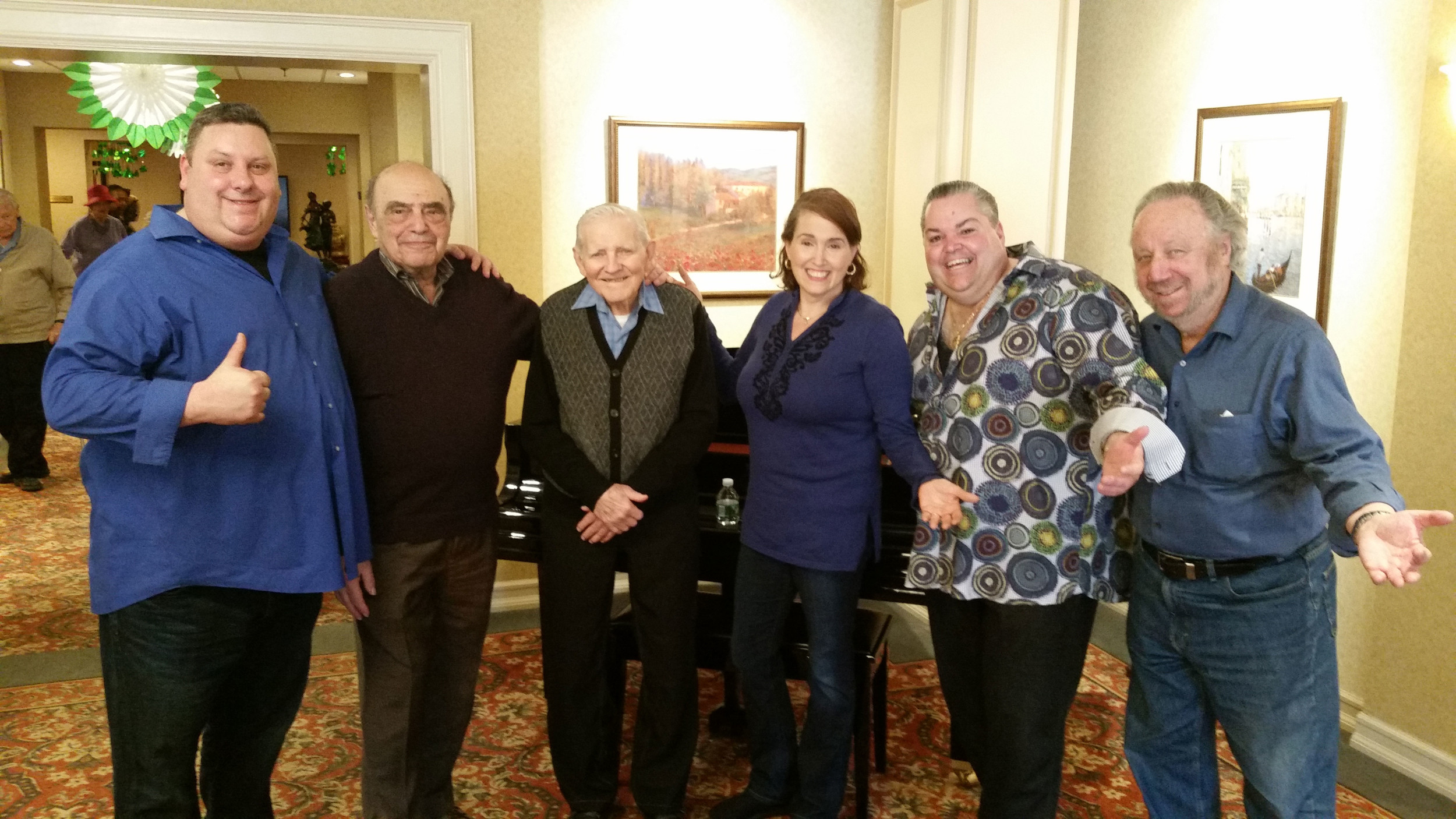 Left to right, Manuel Erias, George Saltz, Fred Mueller, Debbie Bazza, Pat Marone, and Les Bayer at The Regency Assisted Living. Each comedian volunteered their time to support Mueller's dreams.