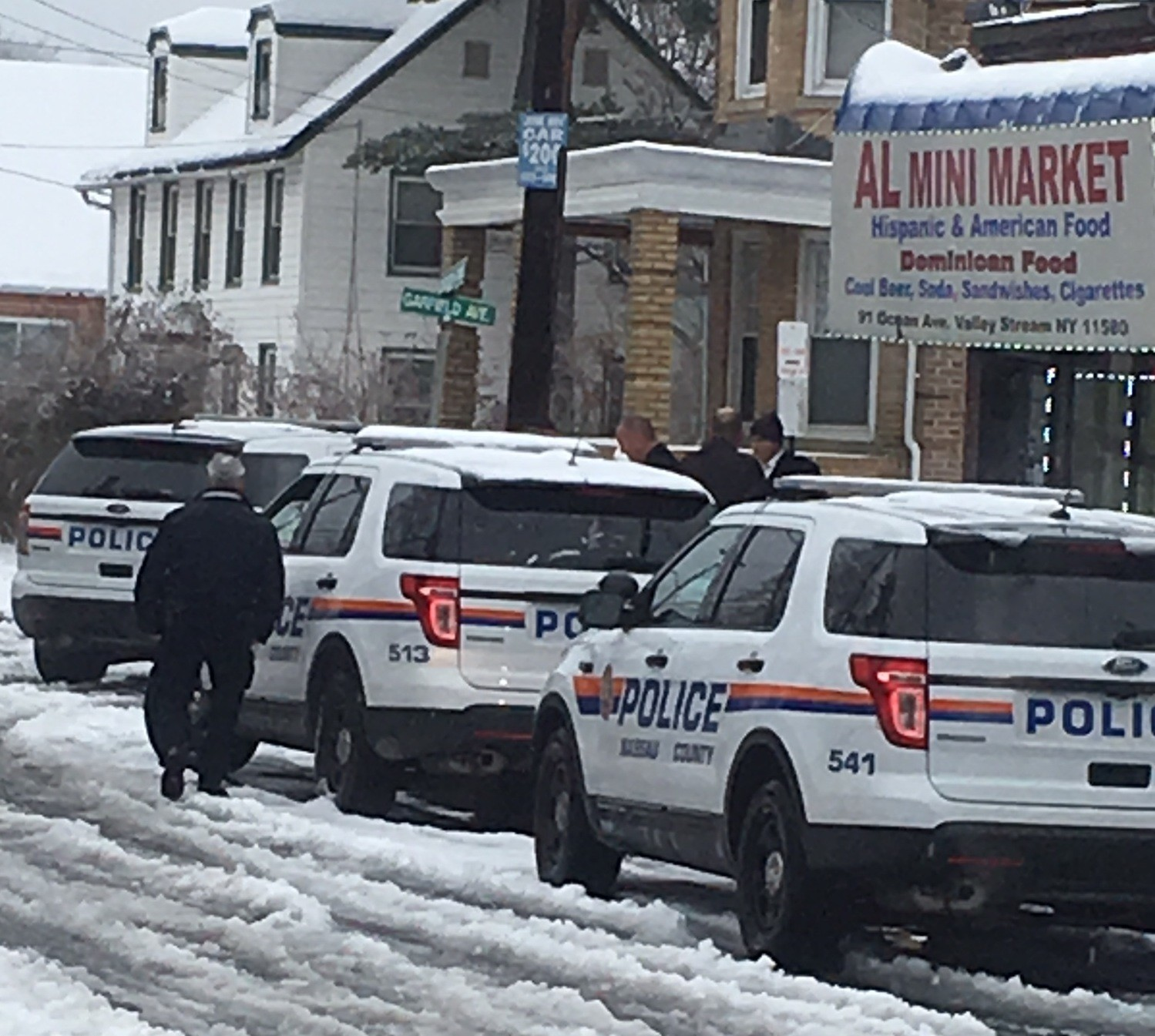 Members from the Nassau County Police Department's Homicide Squad handled the investigation on Saturday at the AL Mini Mart.
