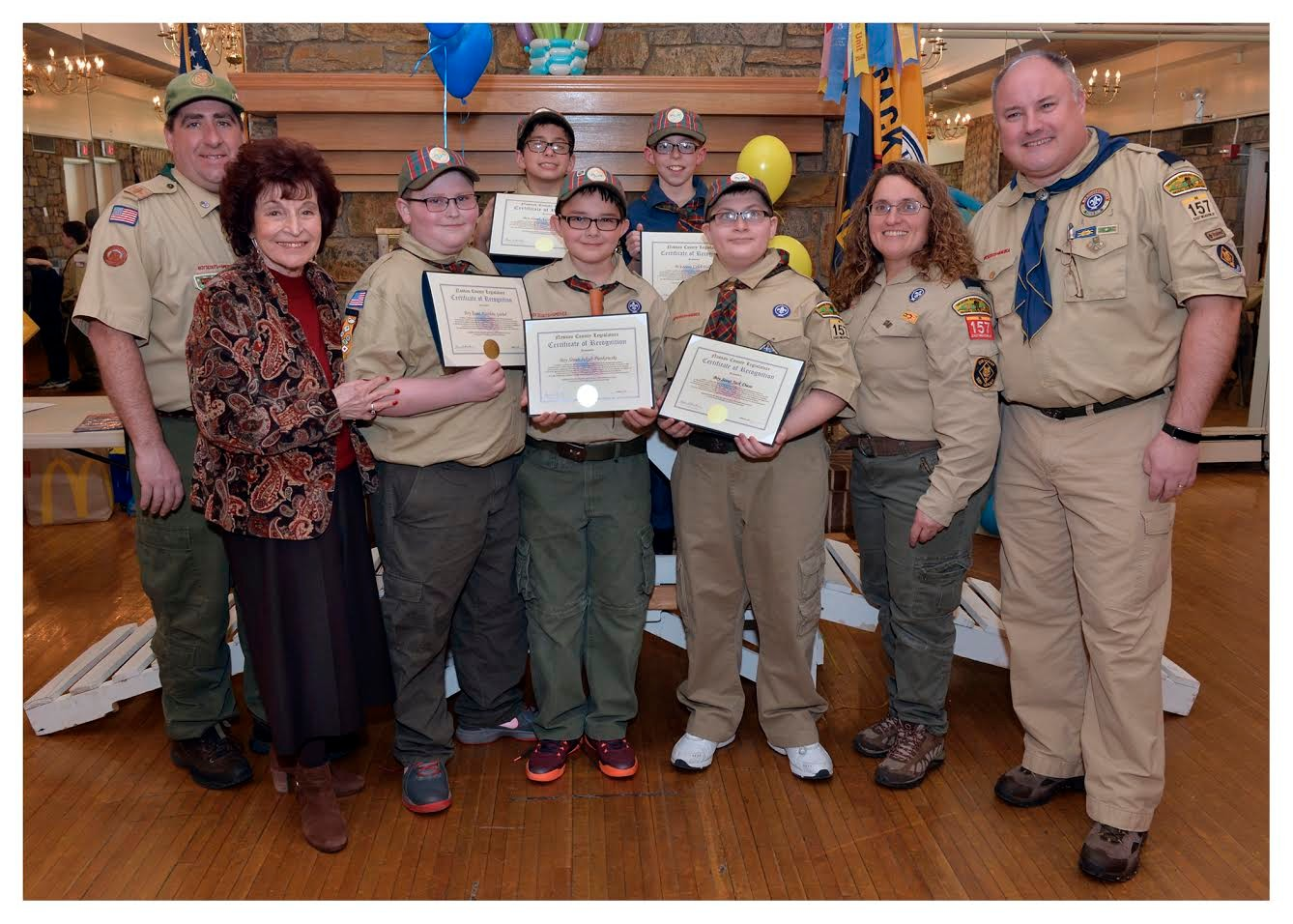 Scout Master Rodie Geoghegan, left, first row, Presiding Officer Norma Gonsalves, Scouts Matthew Goebel, Jakub Pienkowski, Jack Dieso, Arrow of Light Leader Marni Schlectman & Cub Master Tim O'Sullivan, and Scouts Aaron Schlectman and Caleb Haller, back row, attended the Blue and Gold Dinner for Cub Scout Pack 157 in North Merrick.