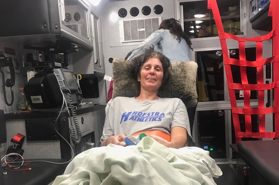 Wantagh Fire Department officials picked up Christine Newins, a 52-year-old Levittown resident and community volunteer in north Wantagh and Seaford, from the airport when she returned from rehabilitation for life-threatening injuries she sustained in a car accident in Carlsbad, Calif.