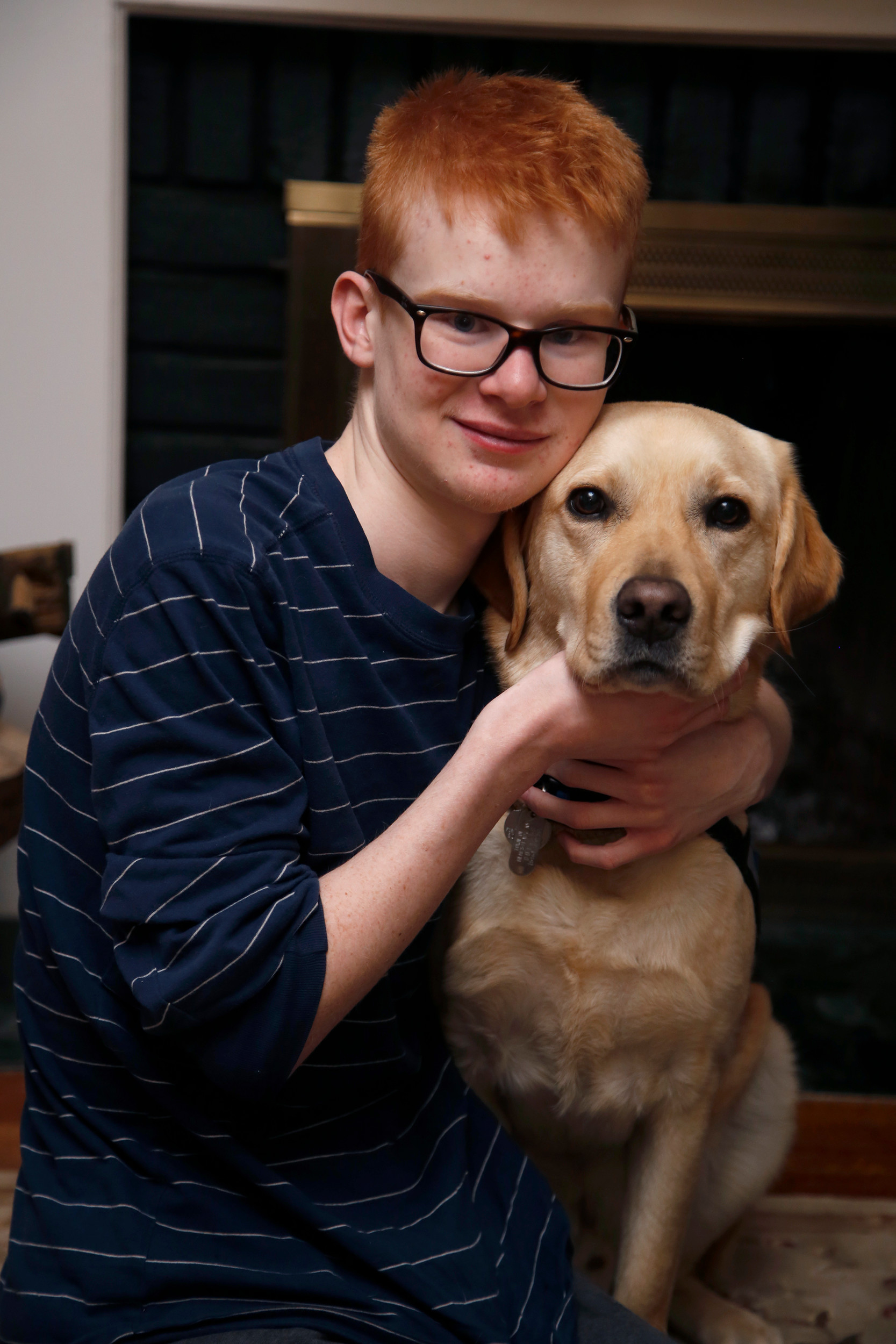 Terence, 14, of Malverne, with Nubert, a highly trained assistance dog that was provided gratis by the non-profit Canine Companions for Independence.