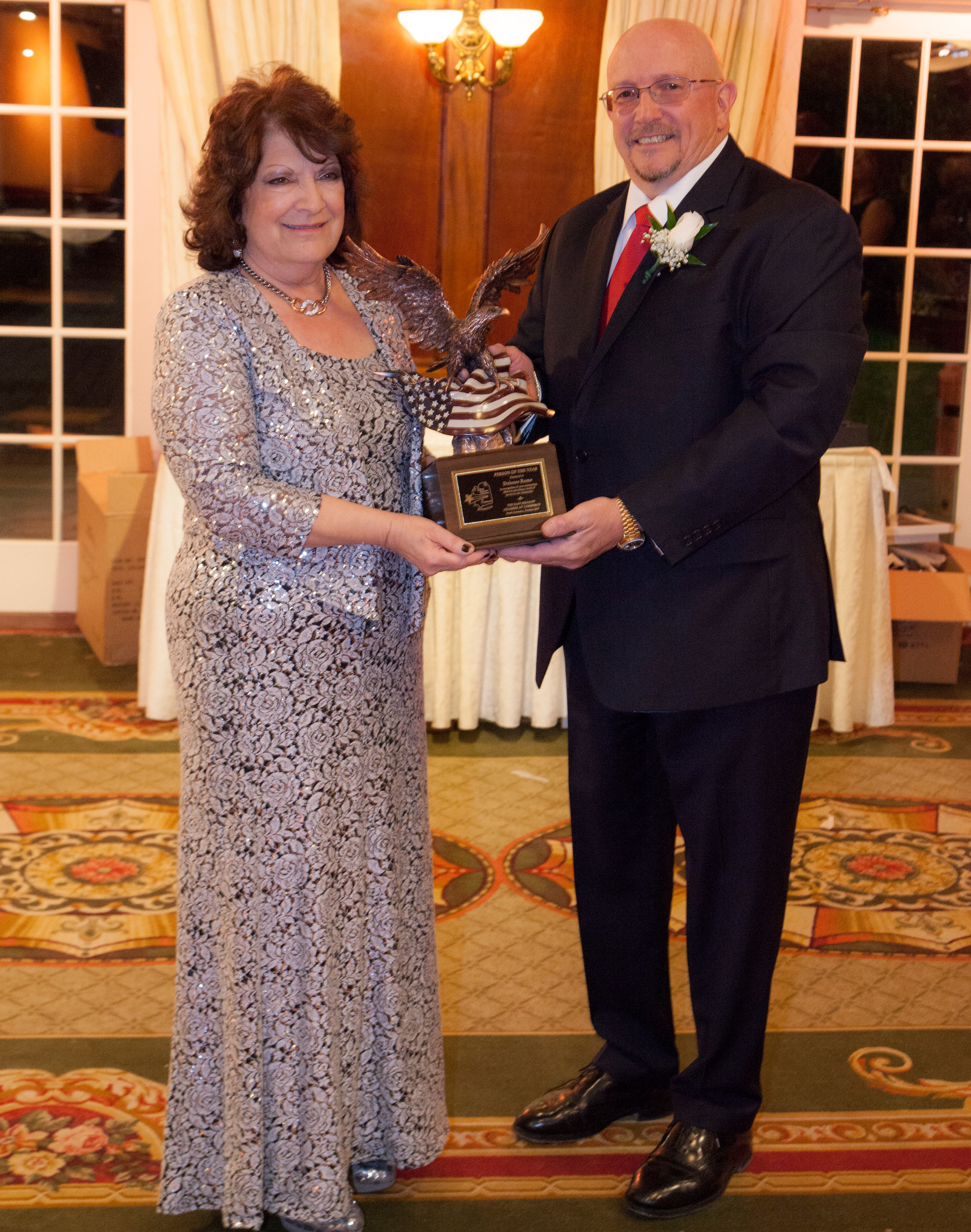Dolores Rome received the East Meadow Chamber of Commerce's 2017 Person of the Year Award from past chamber President Richard Bivone.