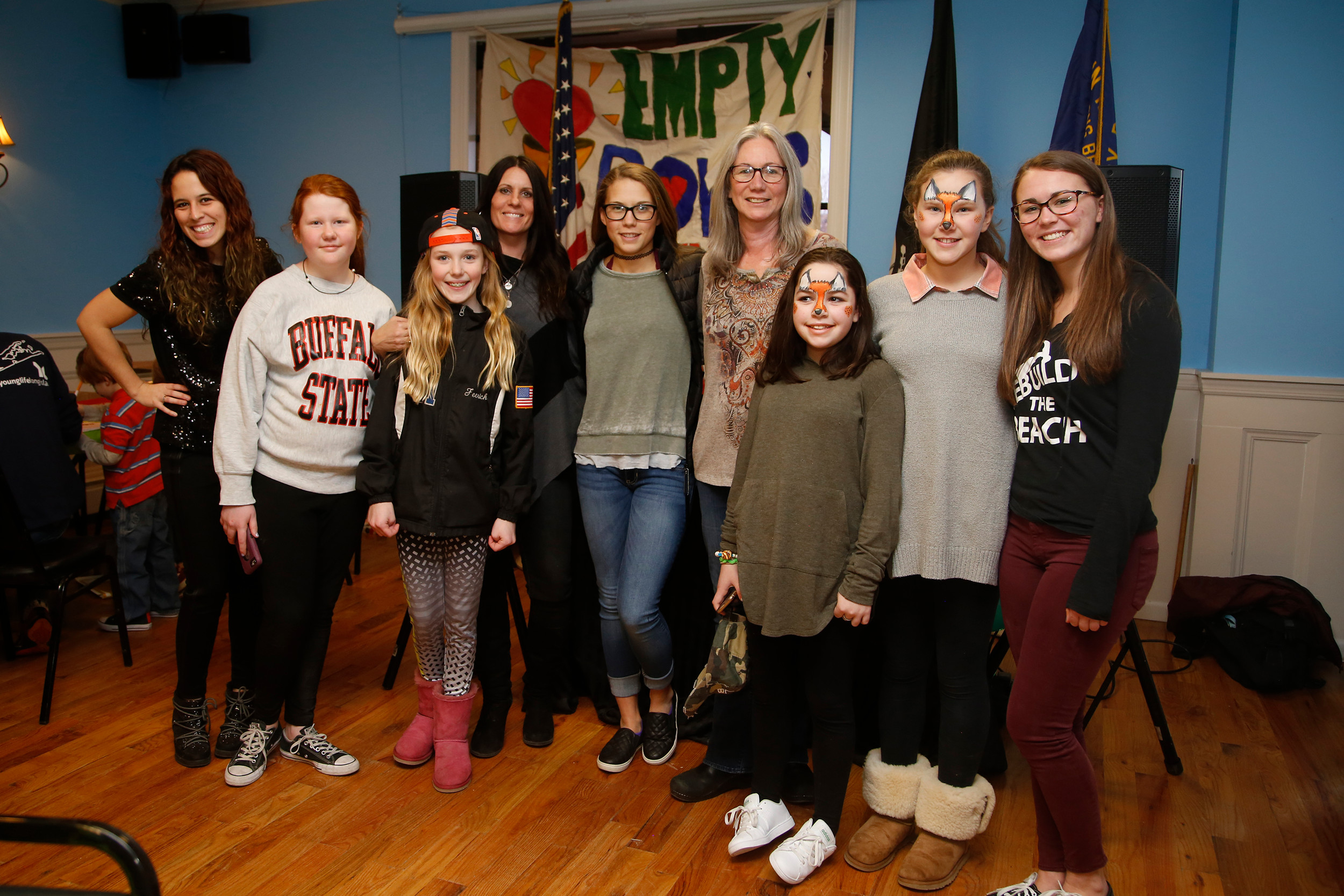 DJ Serenade, left, Keira Fitzgerald, Saoirse Ferrick, Debora Staiano, Charlotte Kyle, Earth Arts owner Michelle Kelly, Mandy Resnick, Allie Kyle and Savannah Kyle at the Empty Bowls dinner party on March 19.