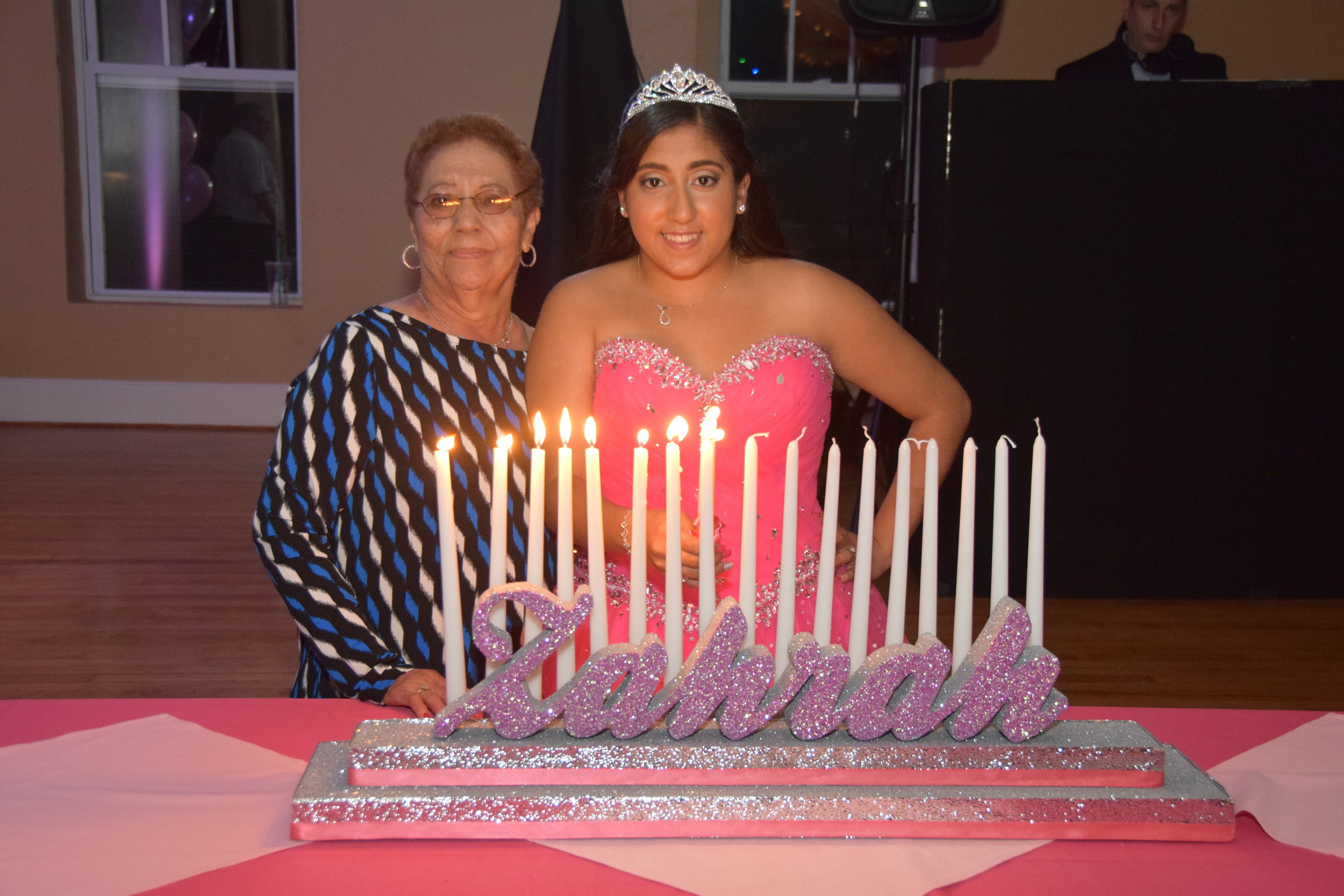 Zahrah Ibrahim said that she has shared many important moments with her grandmother, Graciela. Here, she is helping Zahrah light a sweet sixteen candle in her dedication.