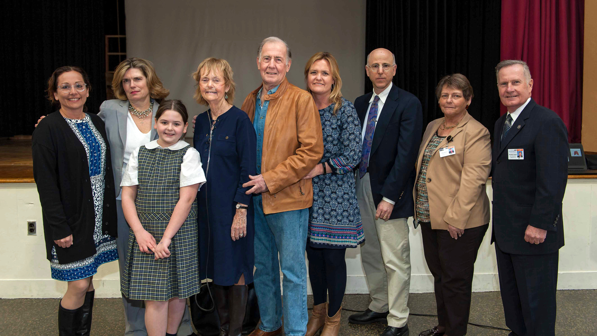 Kiera Harding, a fourth-grader at St. Thomas the Apostle School, spurred her schoolmates to raise money for medical research. From left were Principal Valerie Gigante, Diane Smith, director of Major Gifts at Winthrop; Harding with her grandparents, Mary and Ray Rockensies and her mom, Maryann; speaker Dr. Steve Salzman, Mara Bernstein, administrative director of Pulmonary Outpatient Services at Winthrop, and Richard Rivera, Winthrop administration vice president.