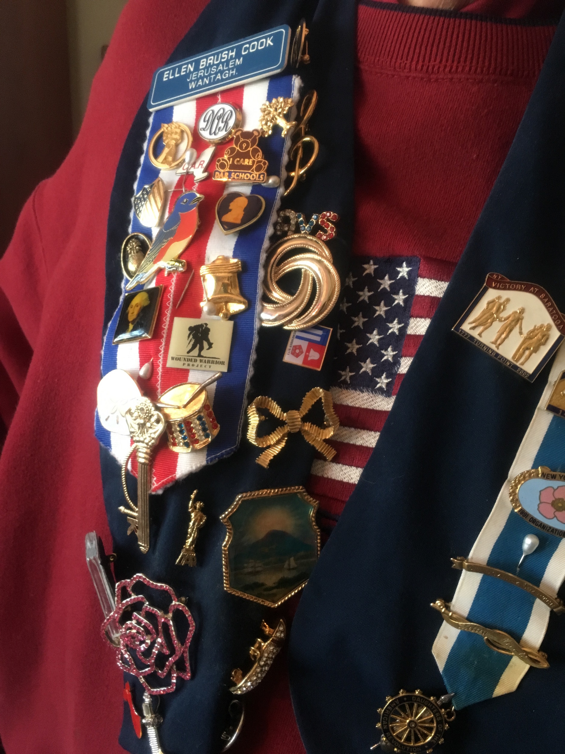 DAR members wear pins that signify their connection to different places and points in history.
