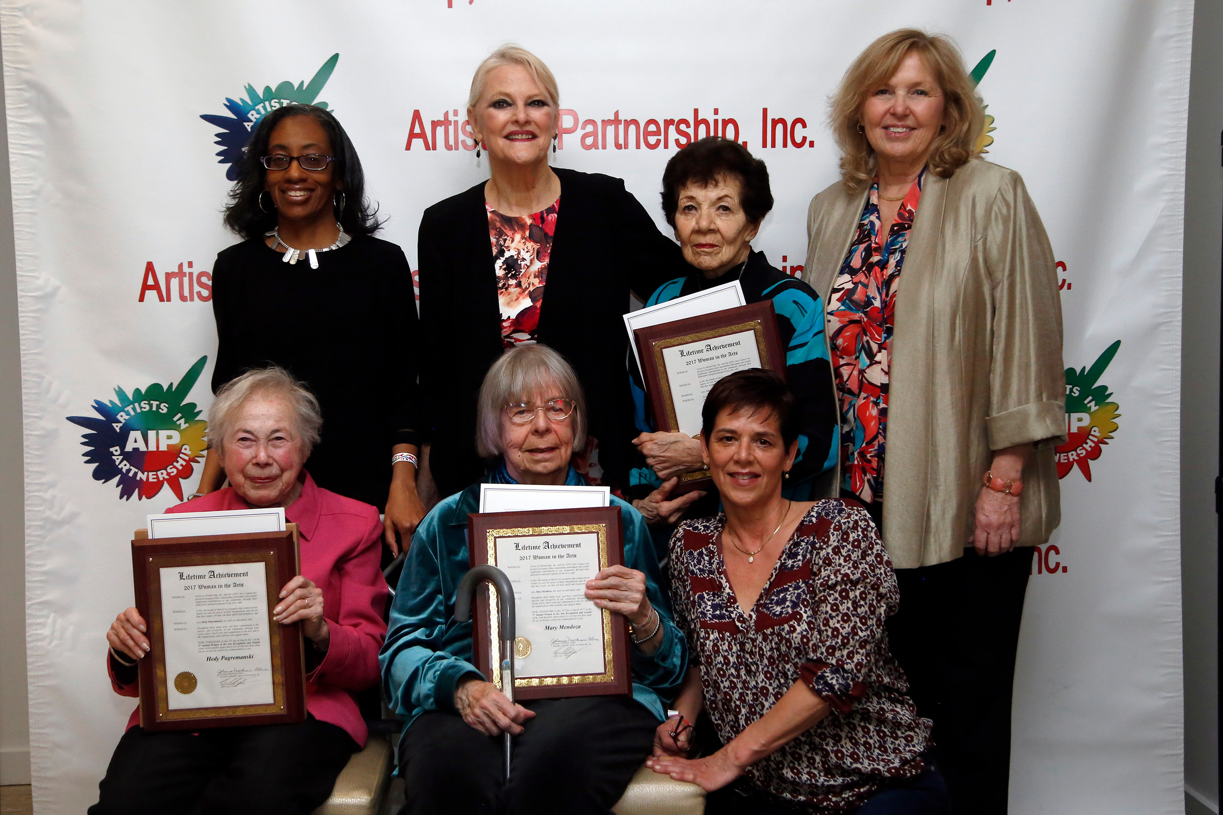 City Councilwoman Anissa Moore, clockwise, from left; Johanna Mathieson-Ellmer, executive director of Youth and Family Services; Naomi Diracles; Nassau County Legislator Denise Ford; Carrie Harris; her mother, Mary Mendoza; and Hedy Pagremanski at the Women in the Arts ceremony on March 24. Diracles, Mendoza and Pagremanski were presented with lifetime achievement awards for their work as artists and support for the arts.