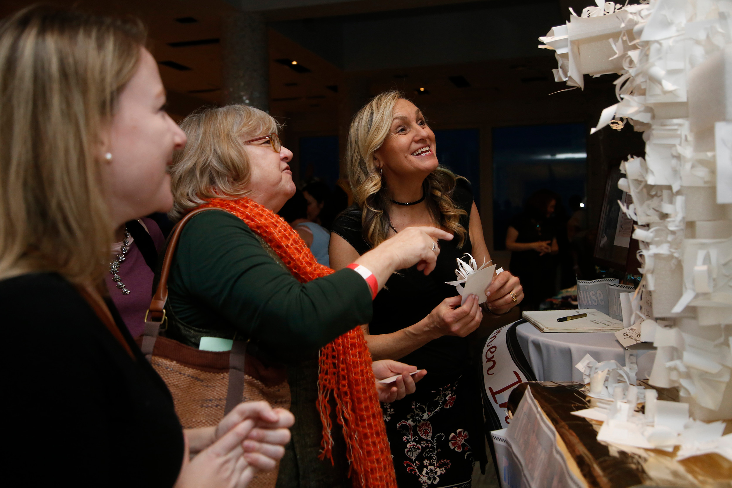 Ayla O'Neill, far left, and her mother, Karen O'Neill, helped artist Laura O'Shaughnessy Swan finish a Louise Nevelson-inspired sculpture at the first annual Women in the Arts awards ceremony at the Allegria Hotel on March 24.