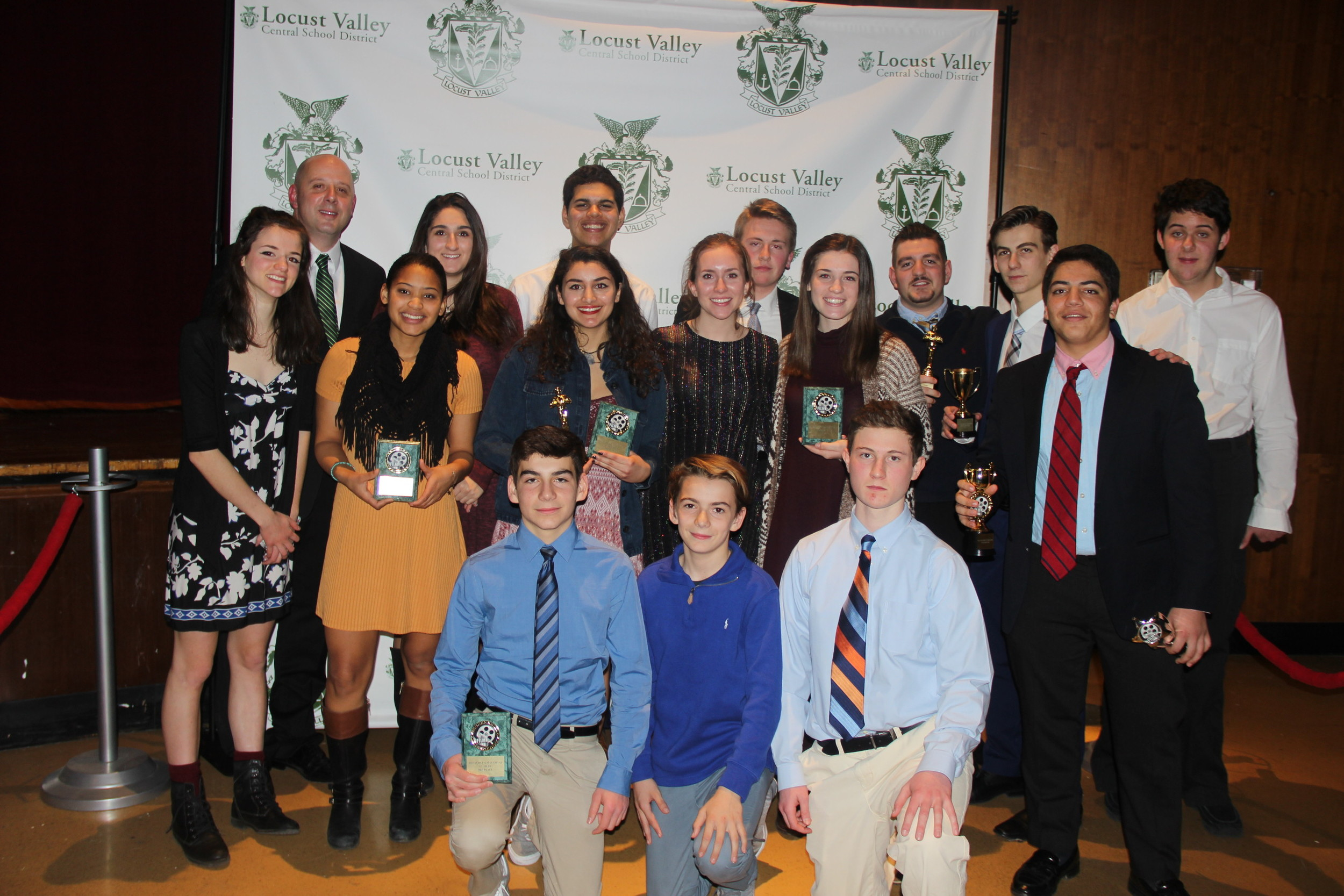 The winning LVHS teams with film teacher Roger Boucher, second from left, at the festival.