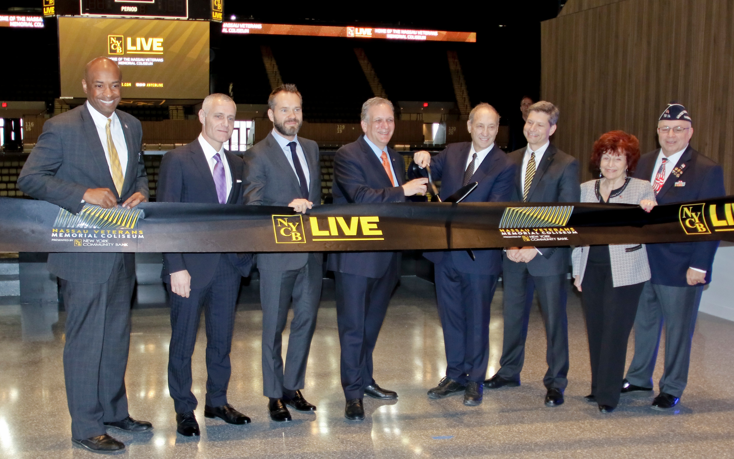 Ribbon cutting at the new coliseum which has undergone a $165 million renovation project. From left, Kevan Abrahams, Brett Yormark, Dmitry Razumov, Ed Mangano, Bruce Ratner, Andrew Kaplan, Norma Gonsalves and Frank Colon.