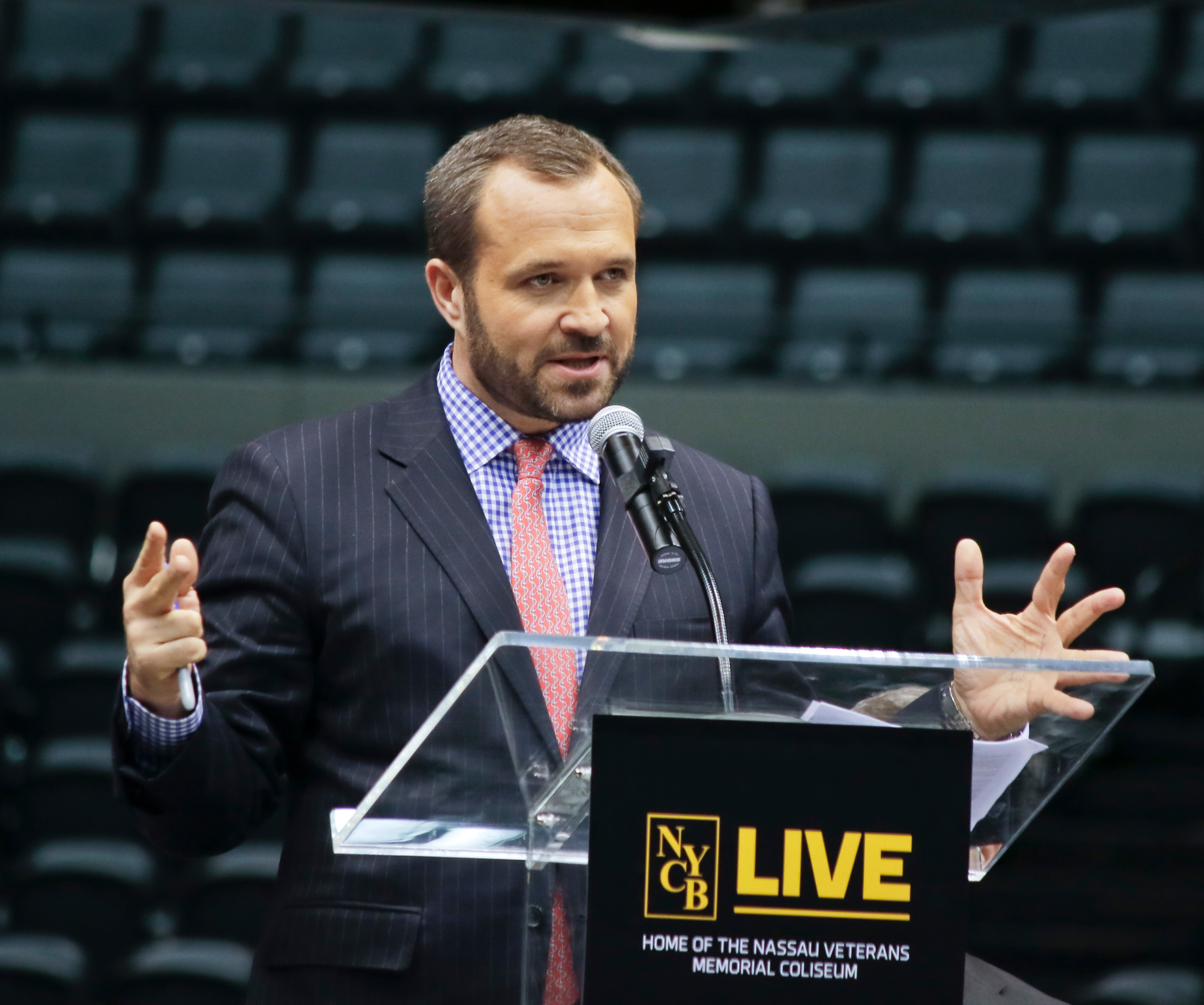 Greg Kelly from the morning show speaks during the opening of the new Nassau Coliseum March 31st.
