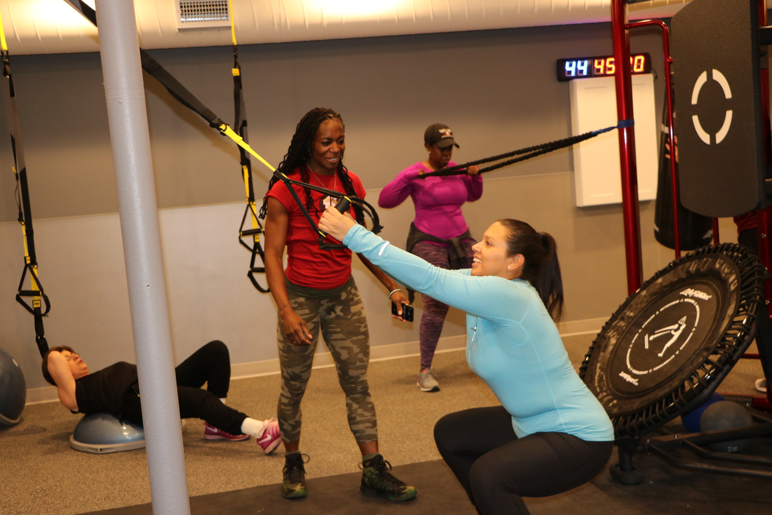 A Fitness 19 trainer helped a patron get in shape during an intensive interval workout.