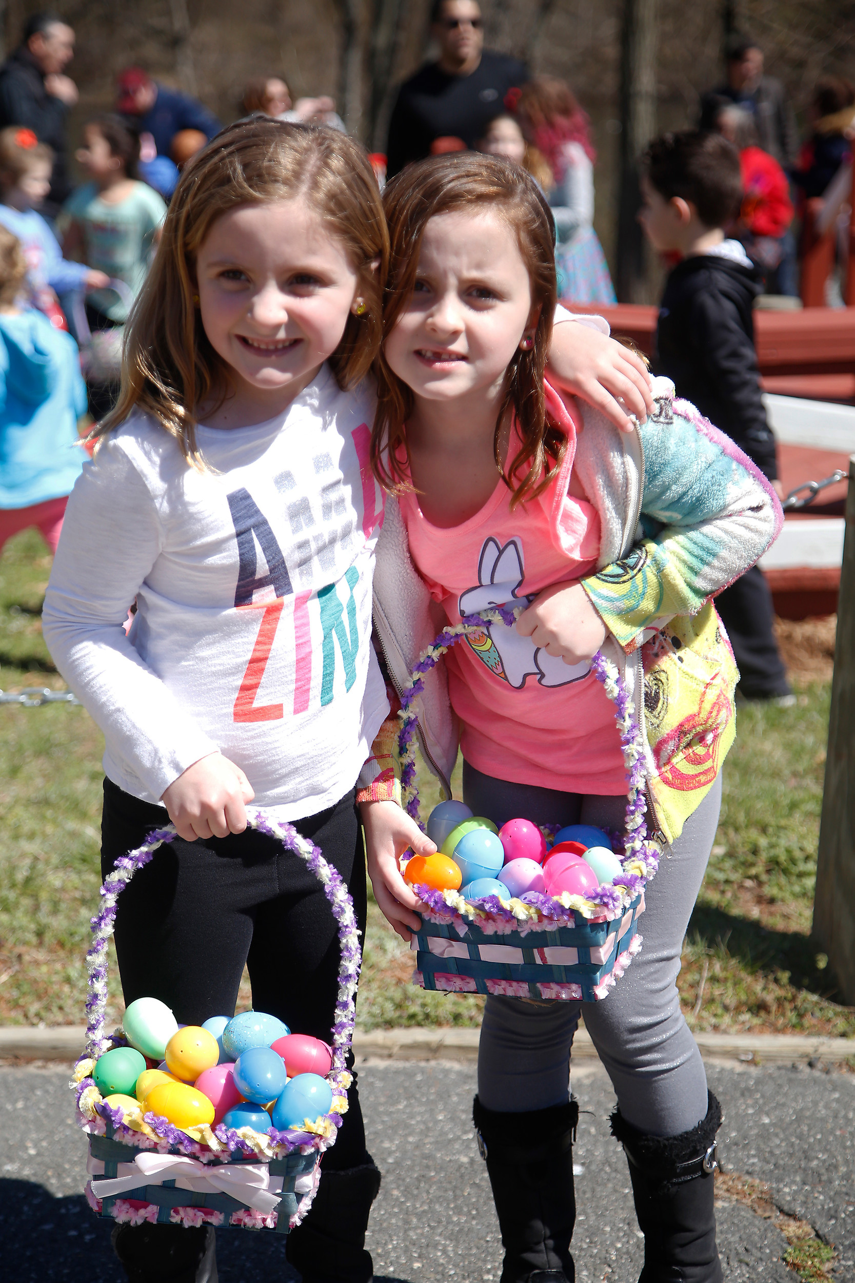 Sisters Maya Krudler, 6, left, and Gianna Krudler, 7, had fun teaming up at the egg hunt.