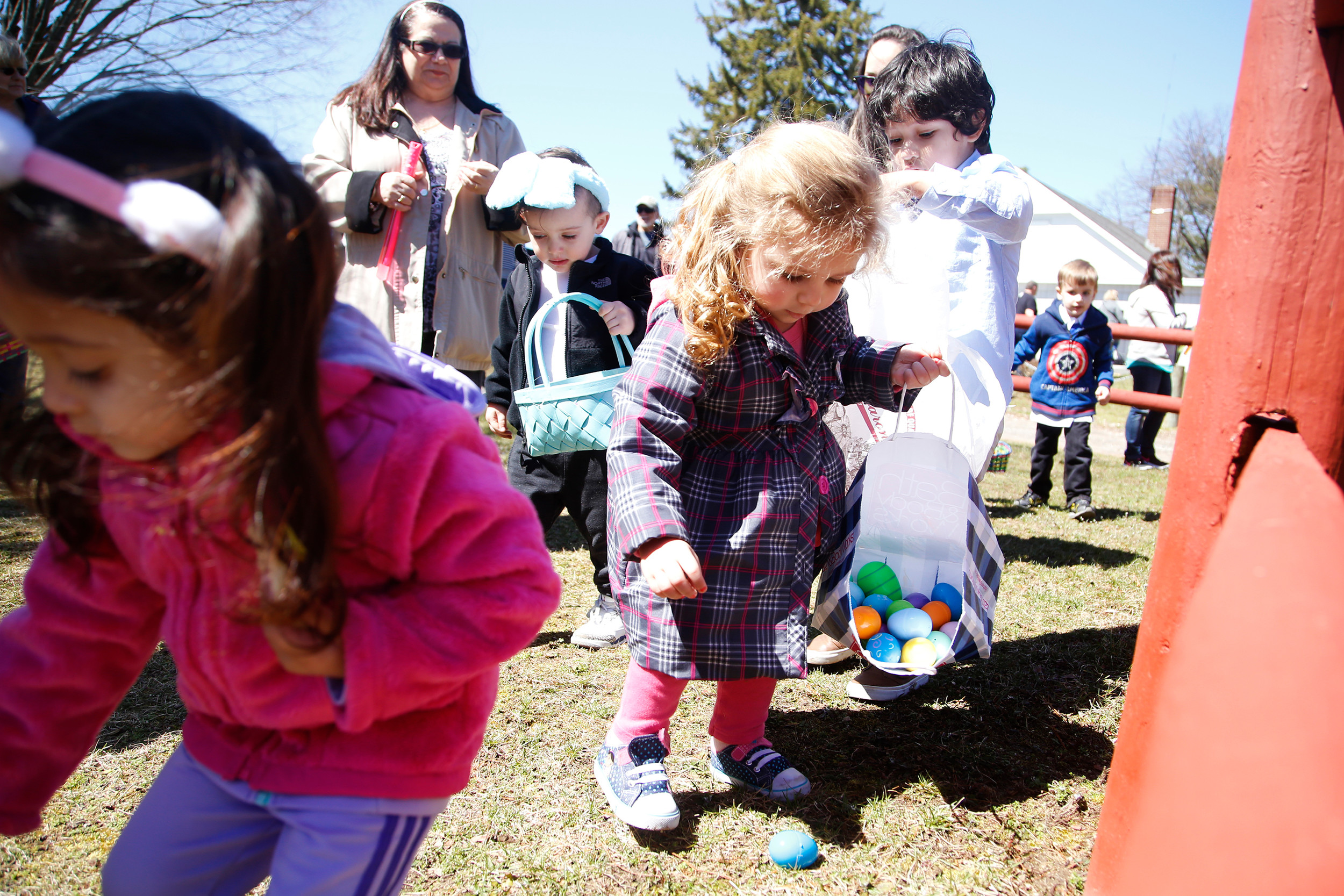 Morgan Zizzo, 2, found a blue egg for her basket.