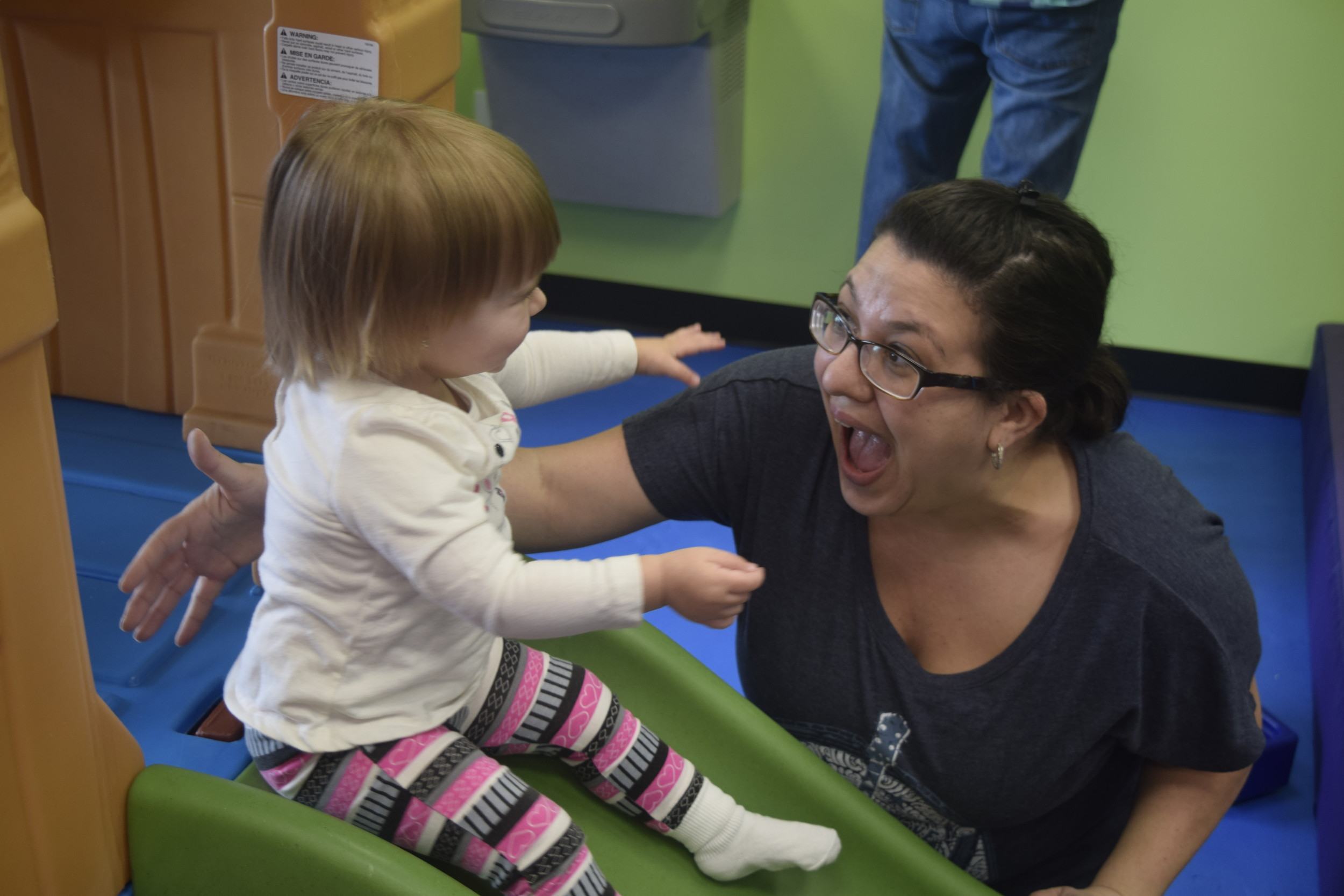 Lauren Kircher helped her 1-year-old daughter, Kaylee, down the slide at Sensory Beans.