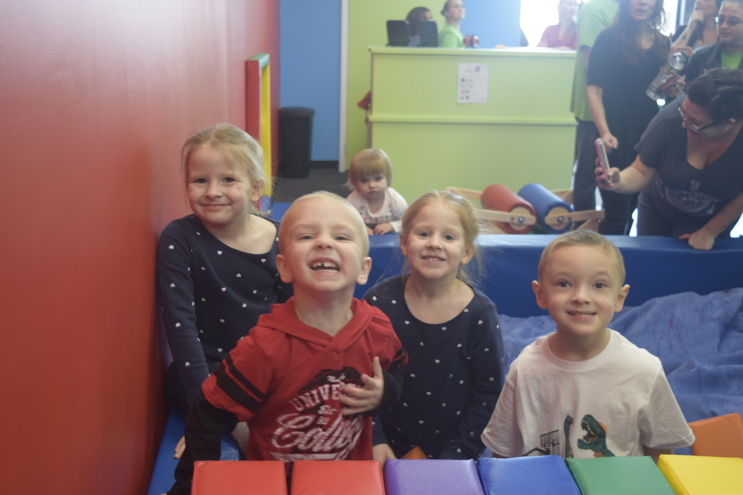 Children enjoyed jumping into the foam pit at the grand opening.