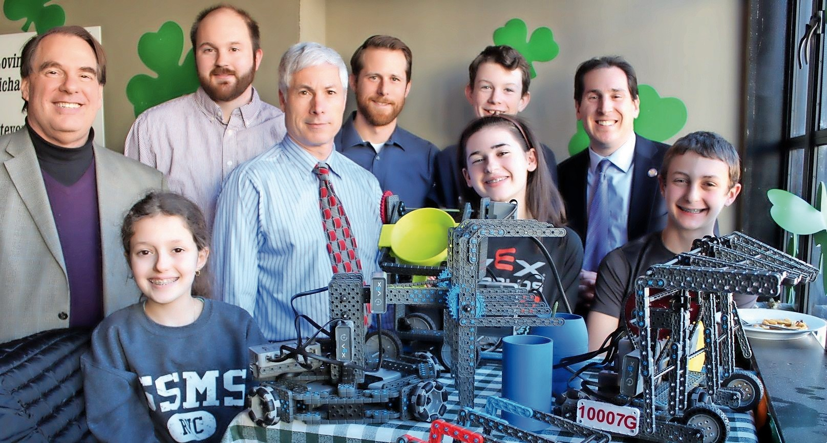 The SSMS robotics team raised over $4,000 during guest bartending night at Monaghan's on March 23. Team members Melanie Koren (front bottom left), Alisa Barker (front second from right), T.J. Egan (back row second from right) and Will Koren (front far right) are heading to the world championships in Kentucky from April 23-25.