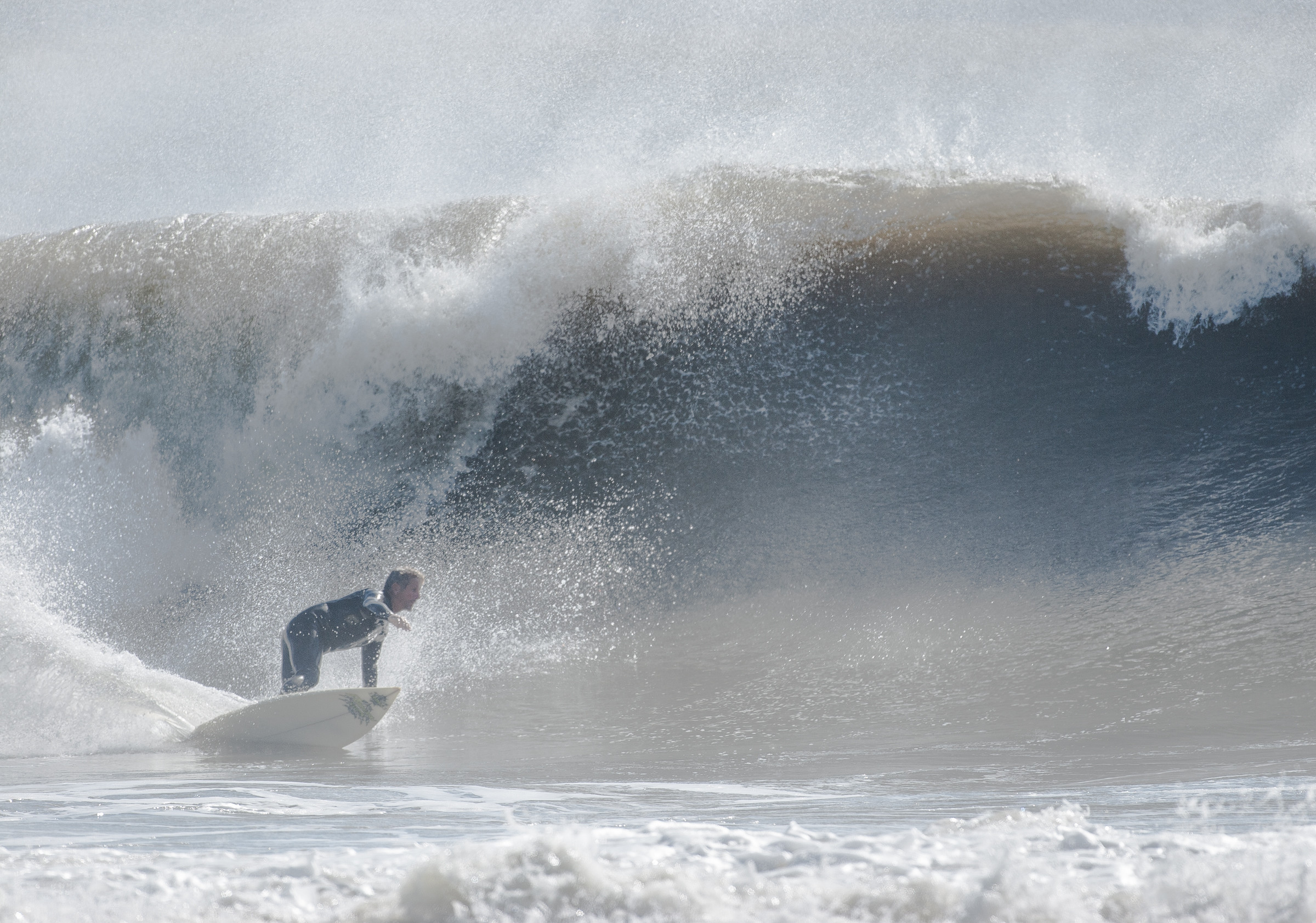 Ward, above on a wave in Long Beach in 2005, was an experienced waterman who rode hurricane swells and big East Coast waves.
