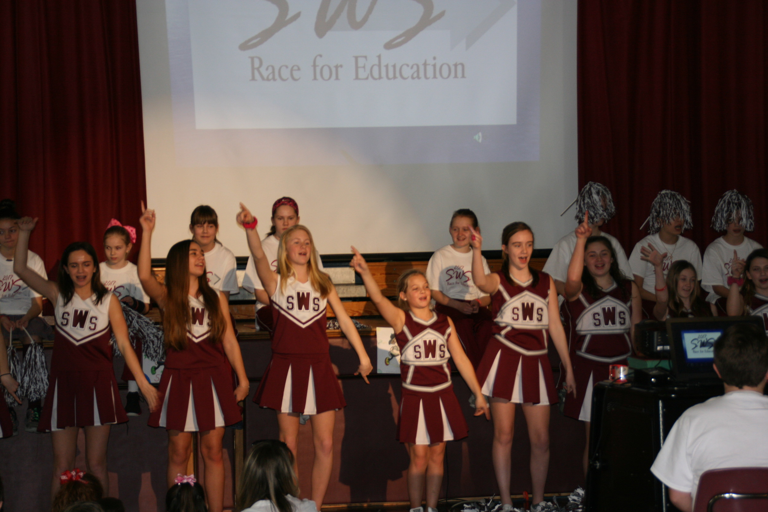 The student committee is the face of the Race for Education. They presented the initiative to their peers with videos and slideshows at a rally on Feb. 14.