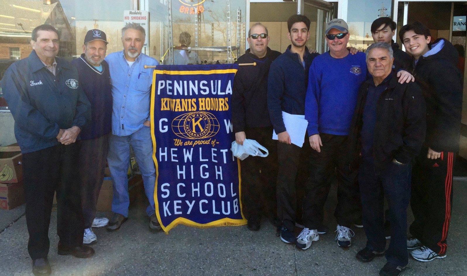 Outside King Kullen supermarket in Hewlett, Peninsula Kiwanis and Hewlett High Key Club members collected food items. From left were Frank Basile, Michael Gliner, Kiwanis President Dominick A. Curra, Larry Romanelli, Yanni Akhavan, Mark Maguire, Justin Ng, Don Esopa and Nathaniel Eisenberg.