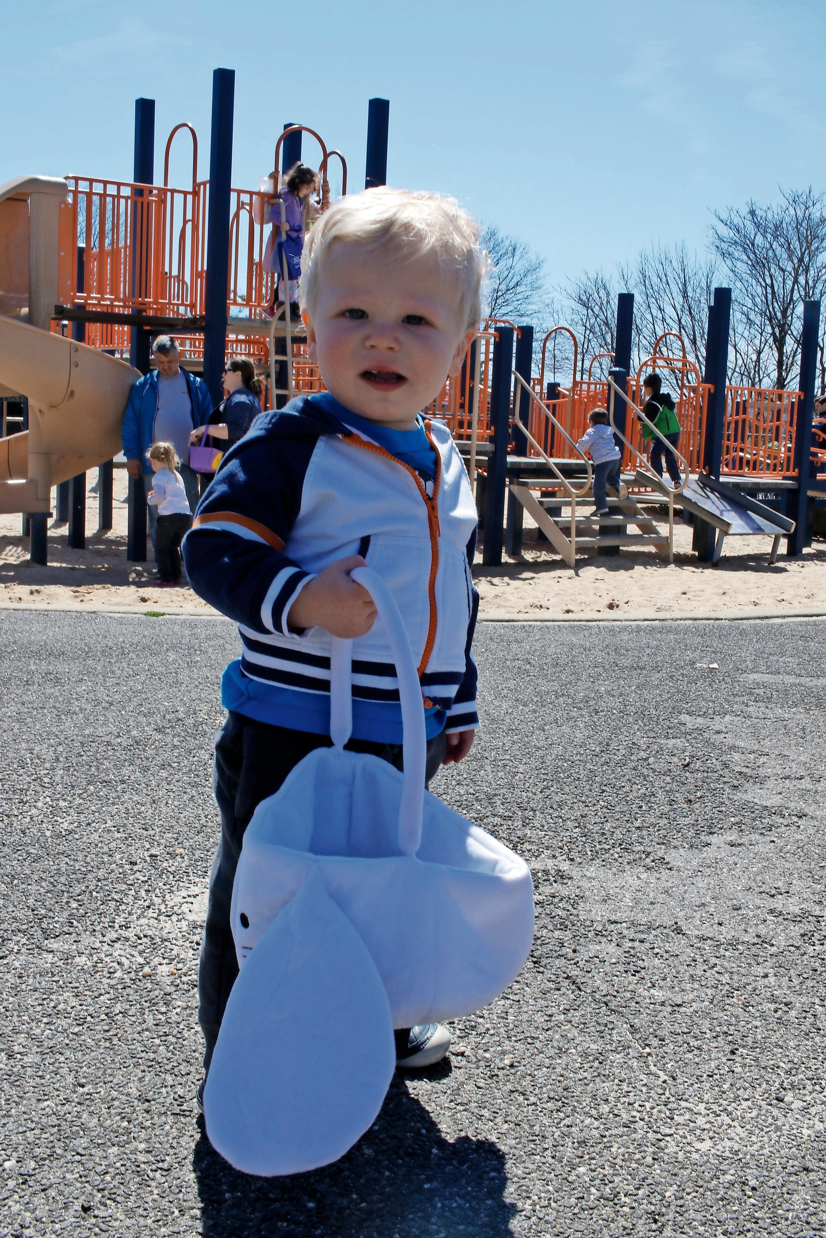 With a basket almost as big as he is, Tyler Troccoli, 15 months old, enjoyed his first egg hunt.