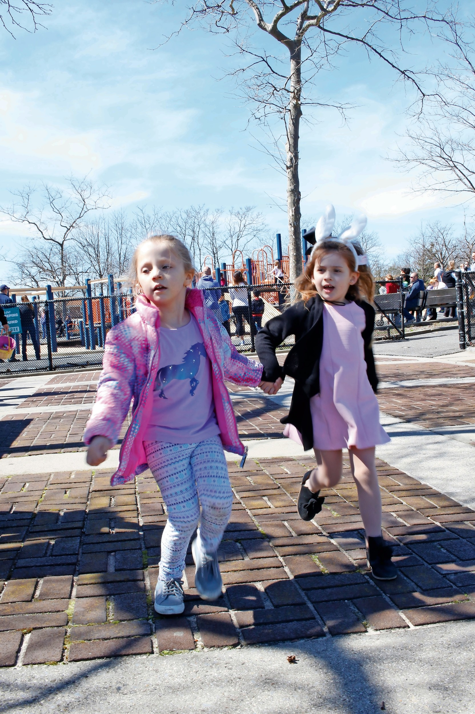 After the egg hunt, Grace Lopex, 5, left, and best friend Olivia Miller, 4, ran towards the refreshment table for some treats.
