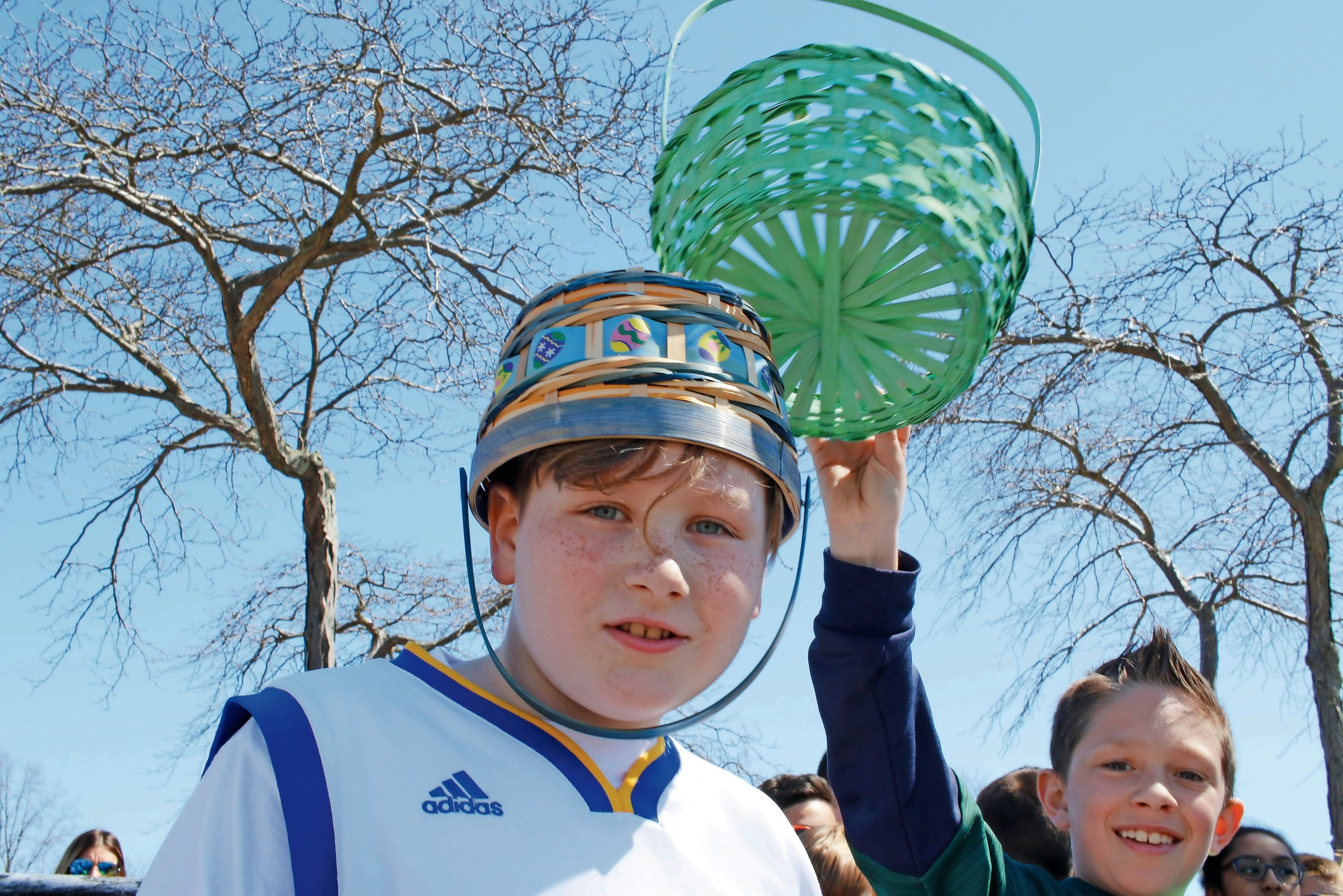 While waiting for the egg hunt to start, Christopher Healy, 9, found other uses for his Easter basket.