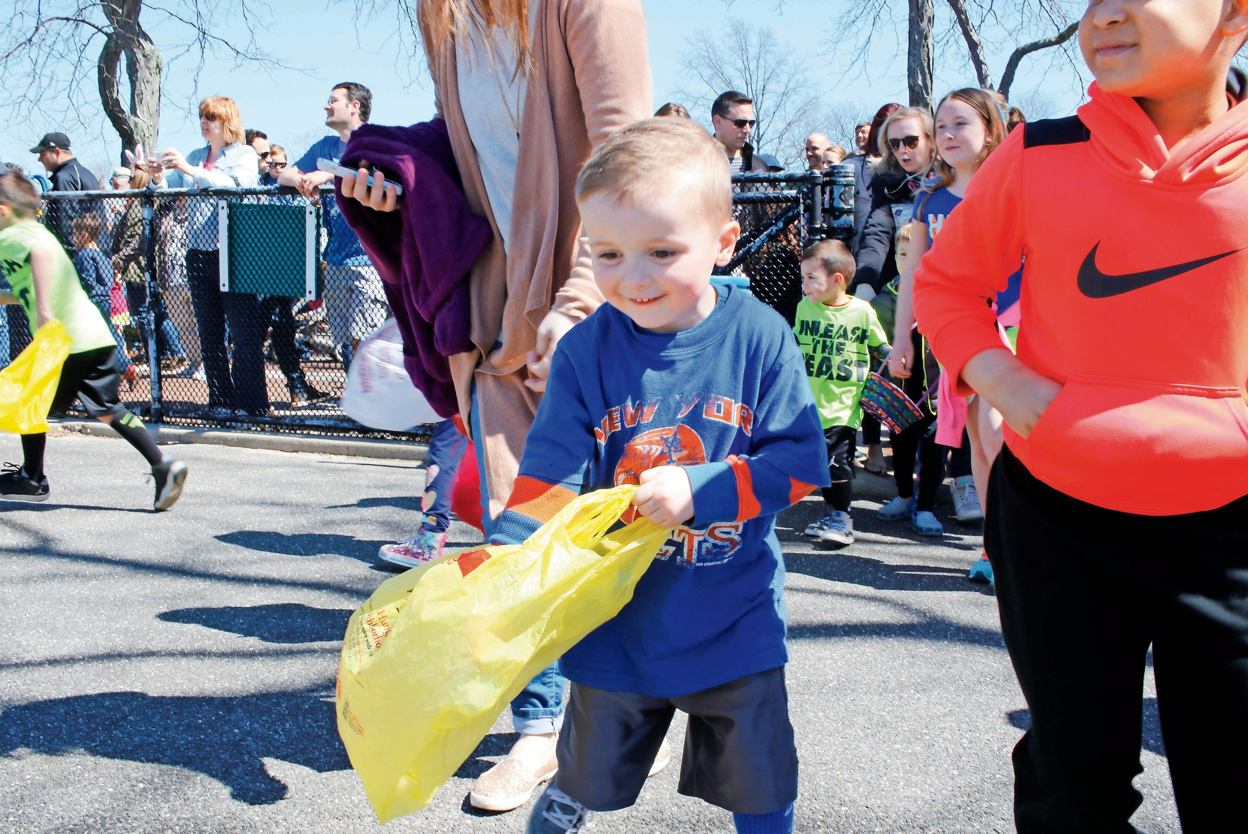 Connor Miller, 4, spotted an egg on the playground at Wantagh Park during the Chamber of Commerce Spring Fun Hunt on April 9.