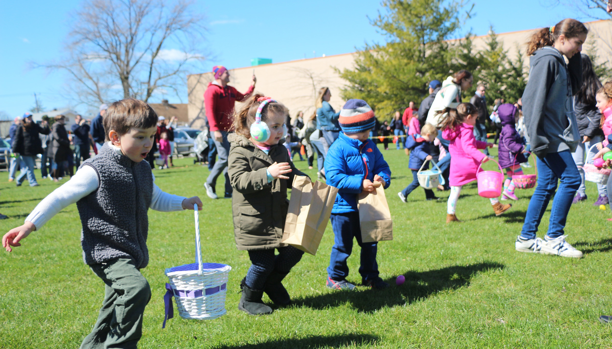 Children raced across the Schoolhouse Green in Oceanside during their annual hunt for Easter eggs last Saturday.