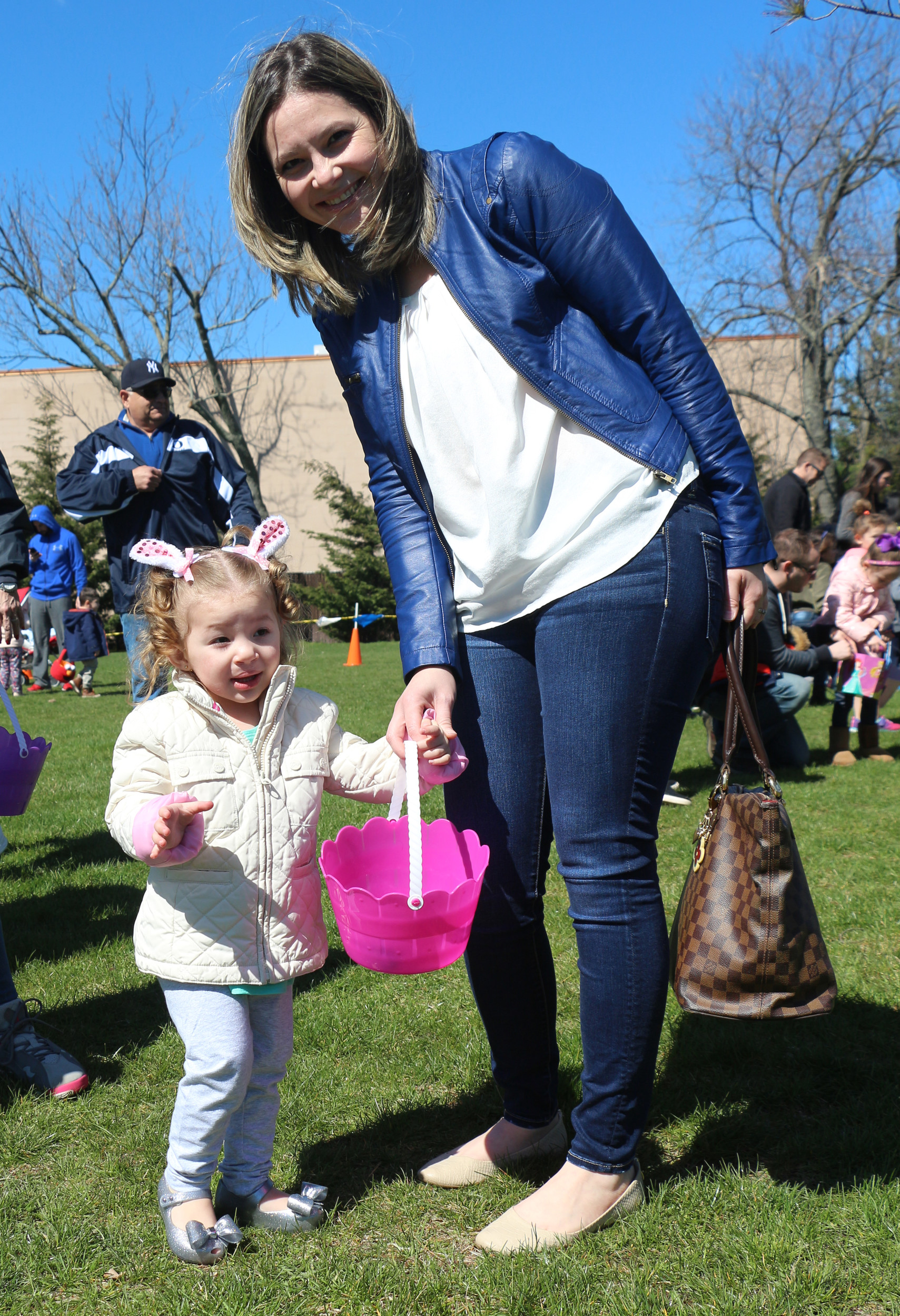 Linda Vacquez, right, and two-year-old Valentina Olmeda hunted for eggs on the Schoolhouse Green.