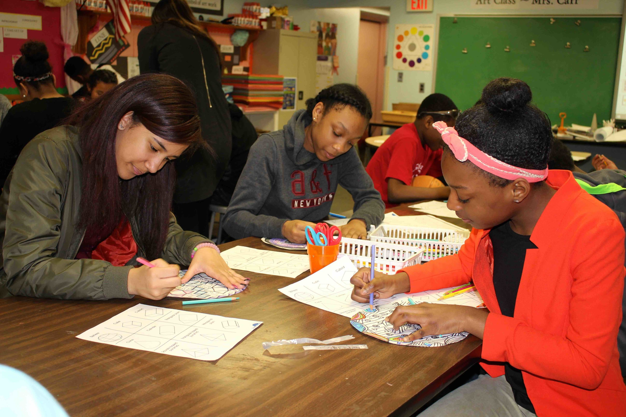 Alyssa Perez, from left, Kayla Allen and Kamoy Campbell joined classmates in creating mandalas using geometry nets.